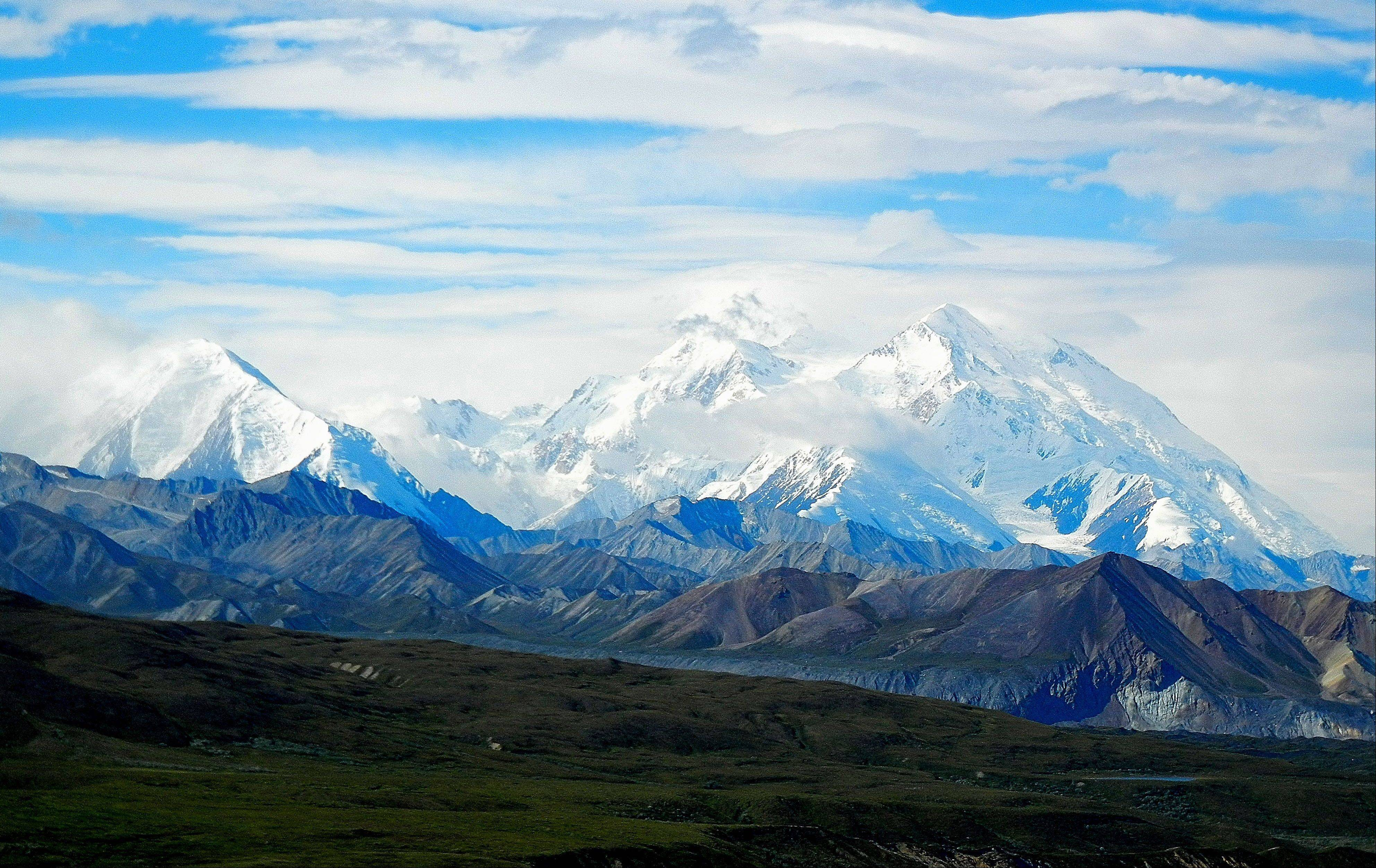 Clouds wrap around Mount McKinley in Alaska as snow covers its peaks last month.