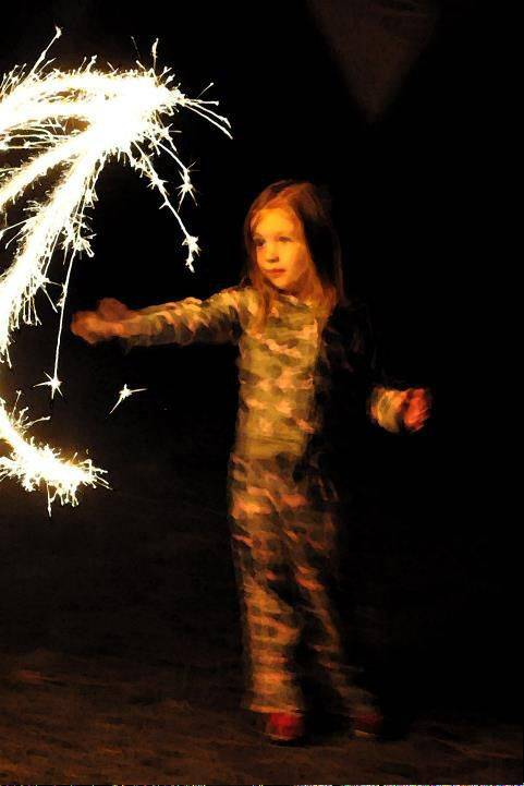 Lillian Hickman makes circles with a sparkler in Manistee, MI last month.