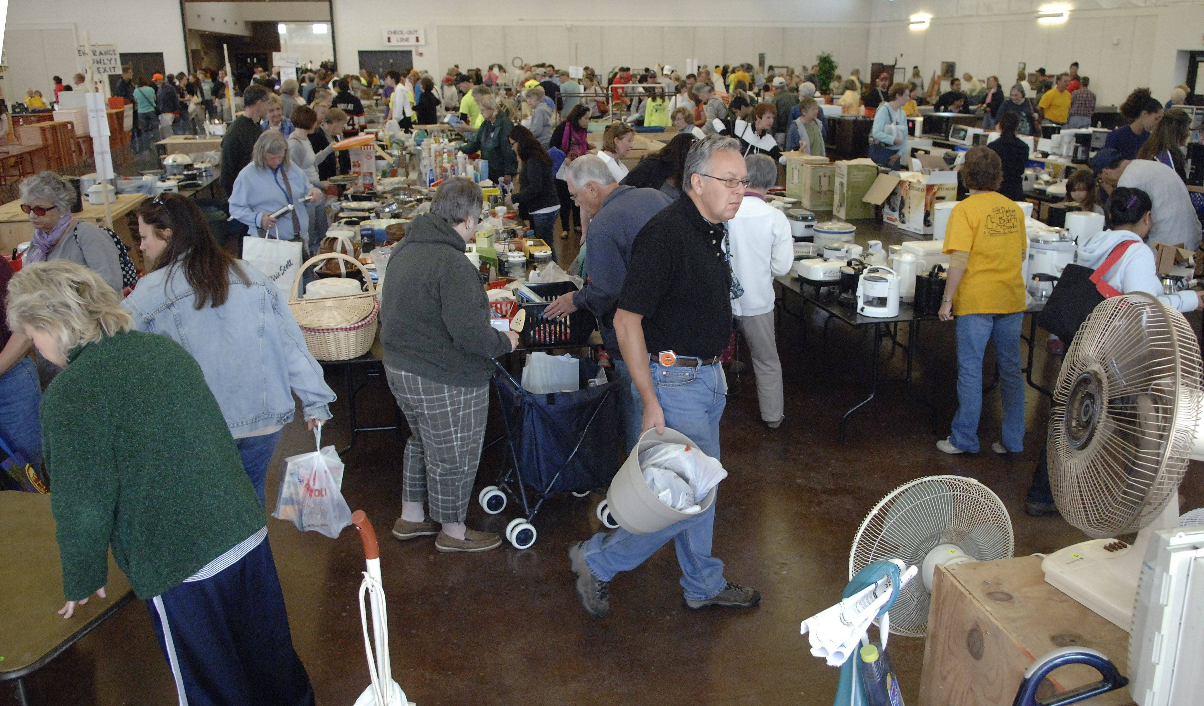 Shoppers packed the kitchen and home appliances area in one of the buildings at the Kane County Fairgrounds for St. Peter Barn Sale Saturday.