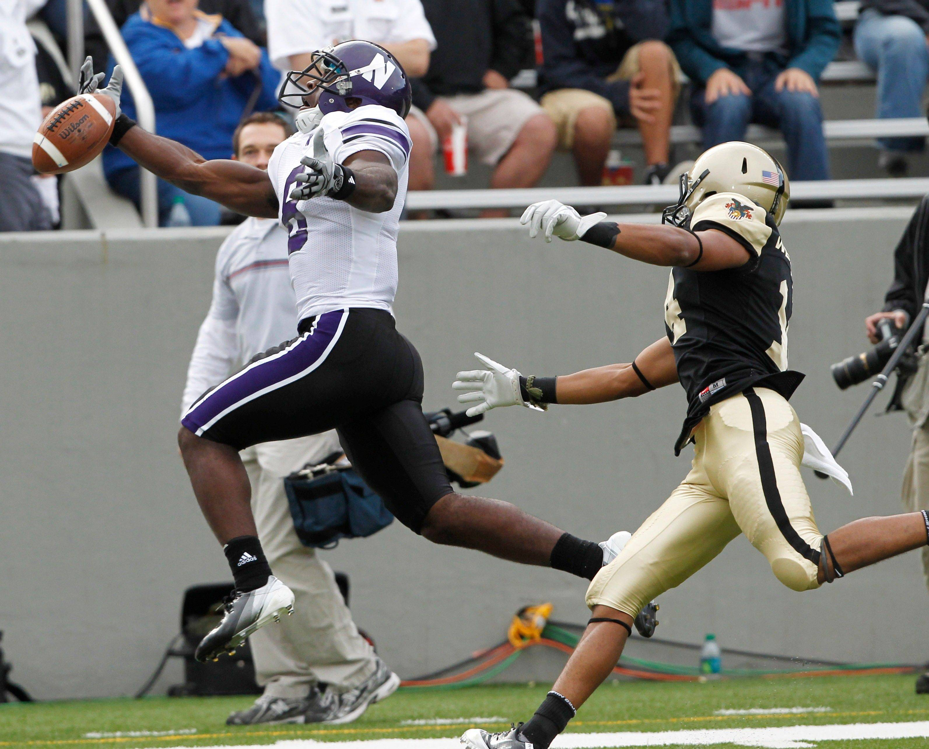 Northwestern's Demetrius Fields (8) can't make the catch in front of Army defender Josh Jackson (14) during the second half of an NCAA college football game in West Point, N.Y., on Saturday, Sept. 17, 2011. Army won, 21-14.