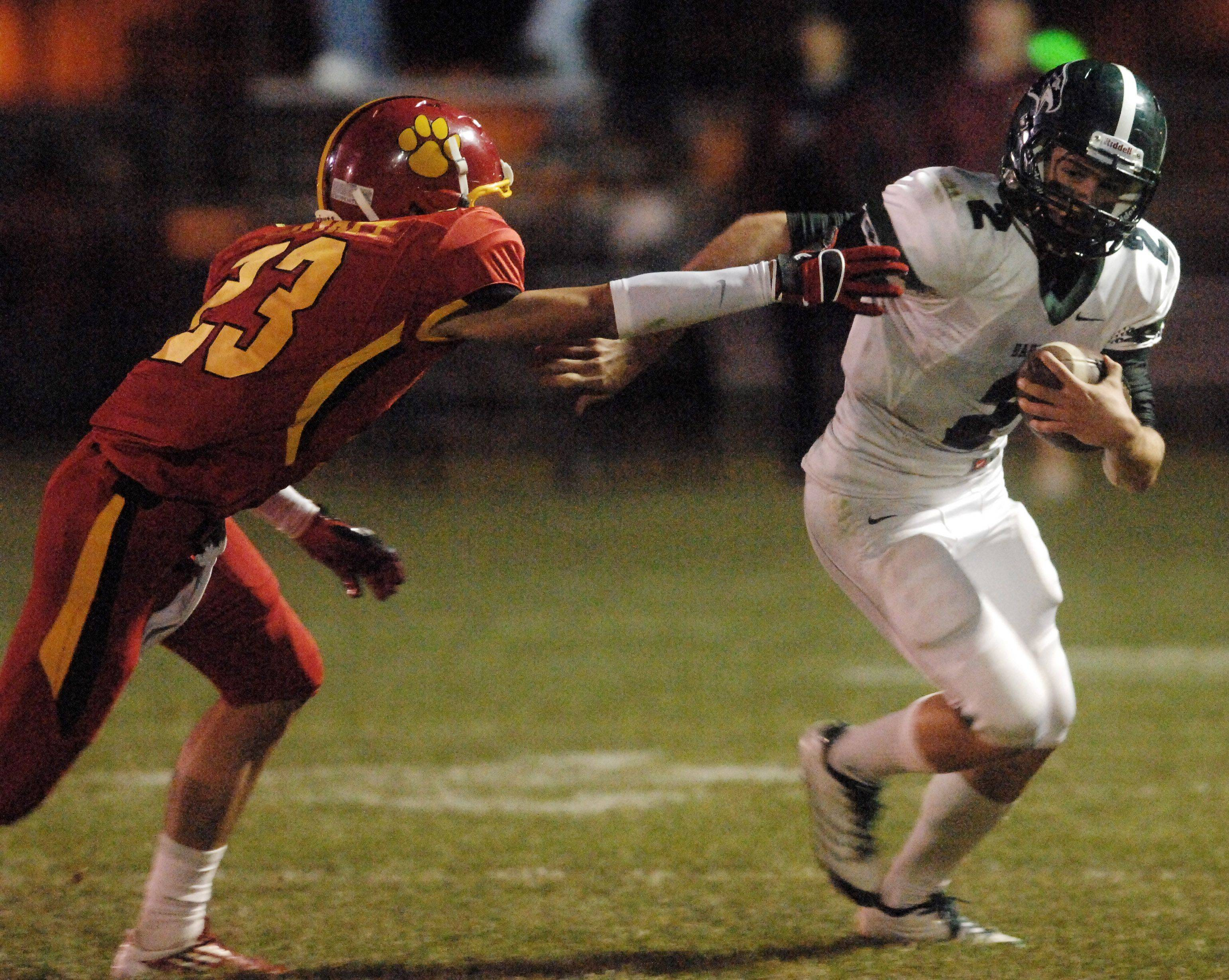 Week 4- Bartlett's Zach Karys breaks for the open field as Batavia's Michael Moffatt gives chase.