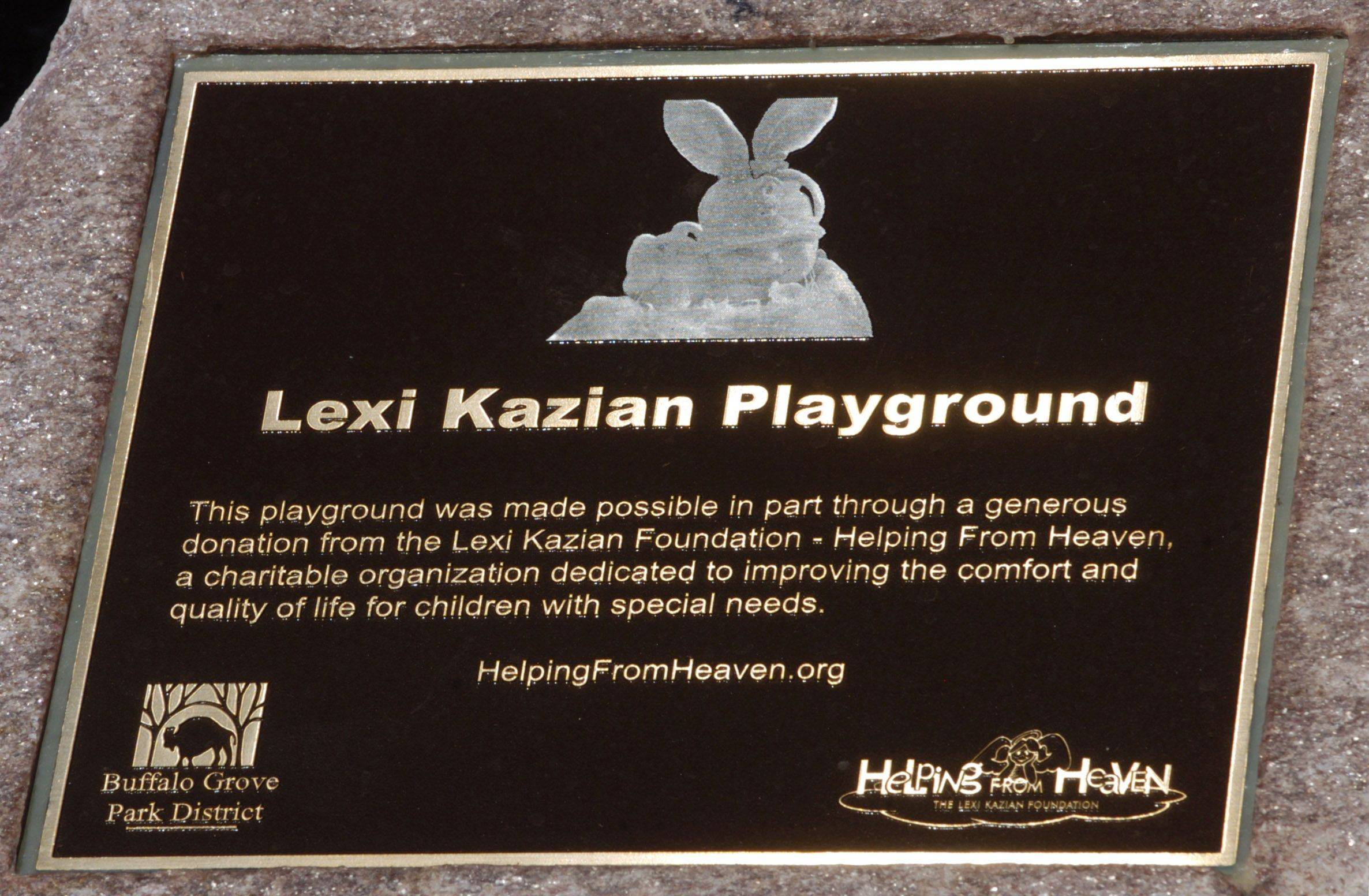 This plaque marks the dedication of the new Alcott Park playground in Buffalo Grove Kristy to Lexi Kazian.