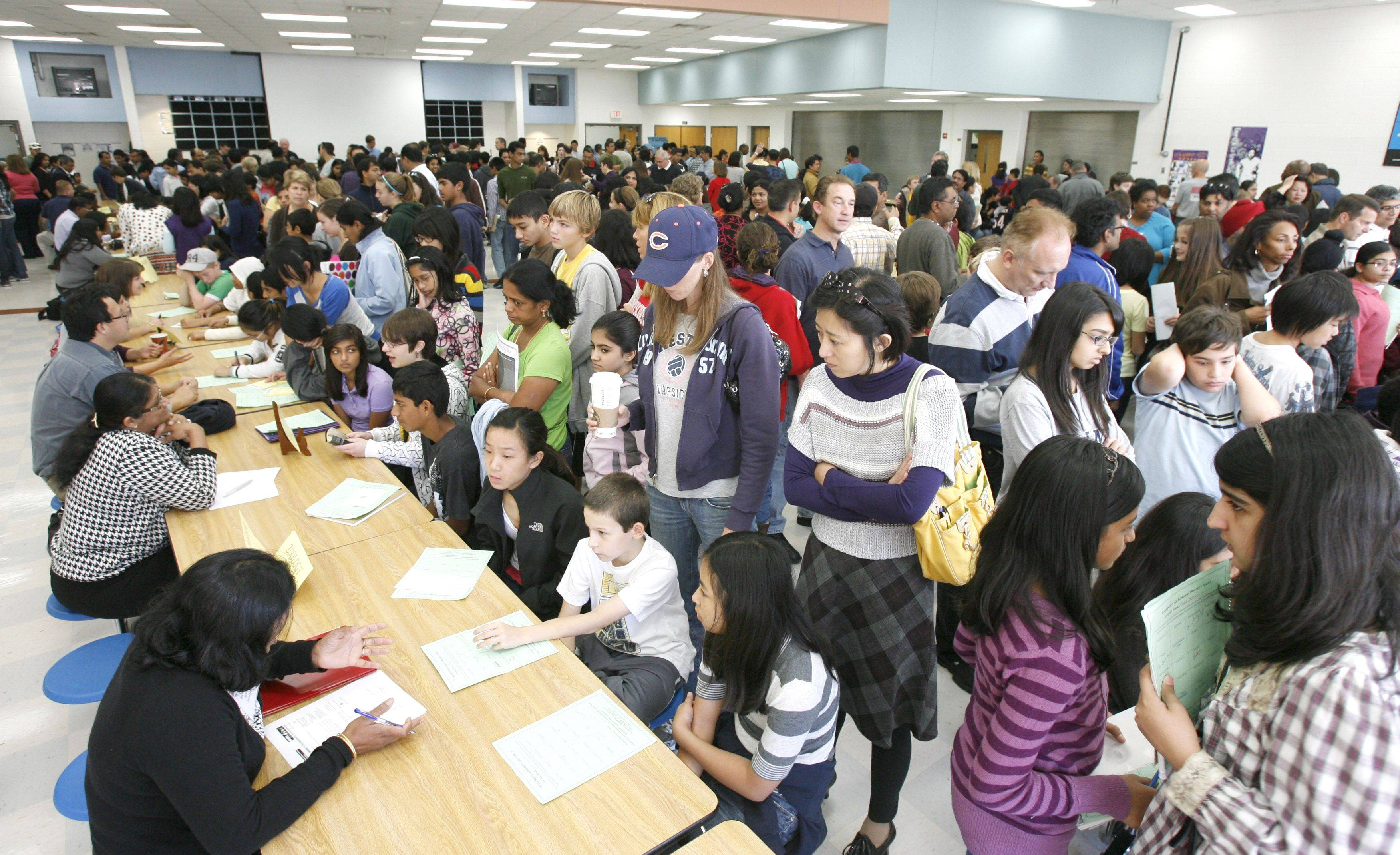"More than 400 people attended the science, technology, engineering and mathematics open house at Scullen Middle School in Naperville. ""This turnout exceeded way beyond our wildest expectations,"" said Jann Hawkins, IJAS chair for the regional fair."