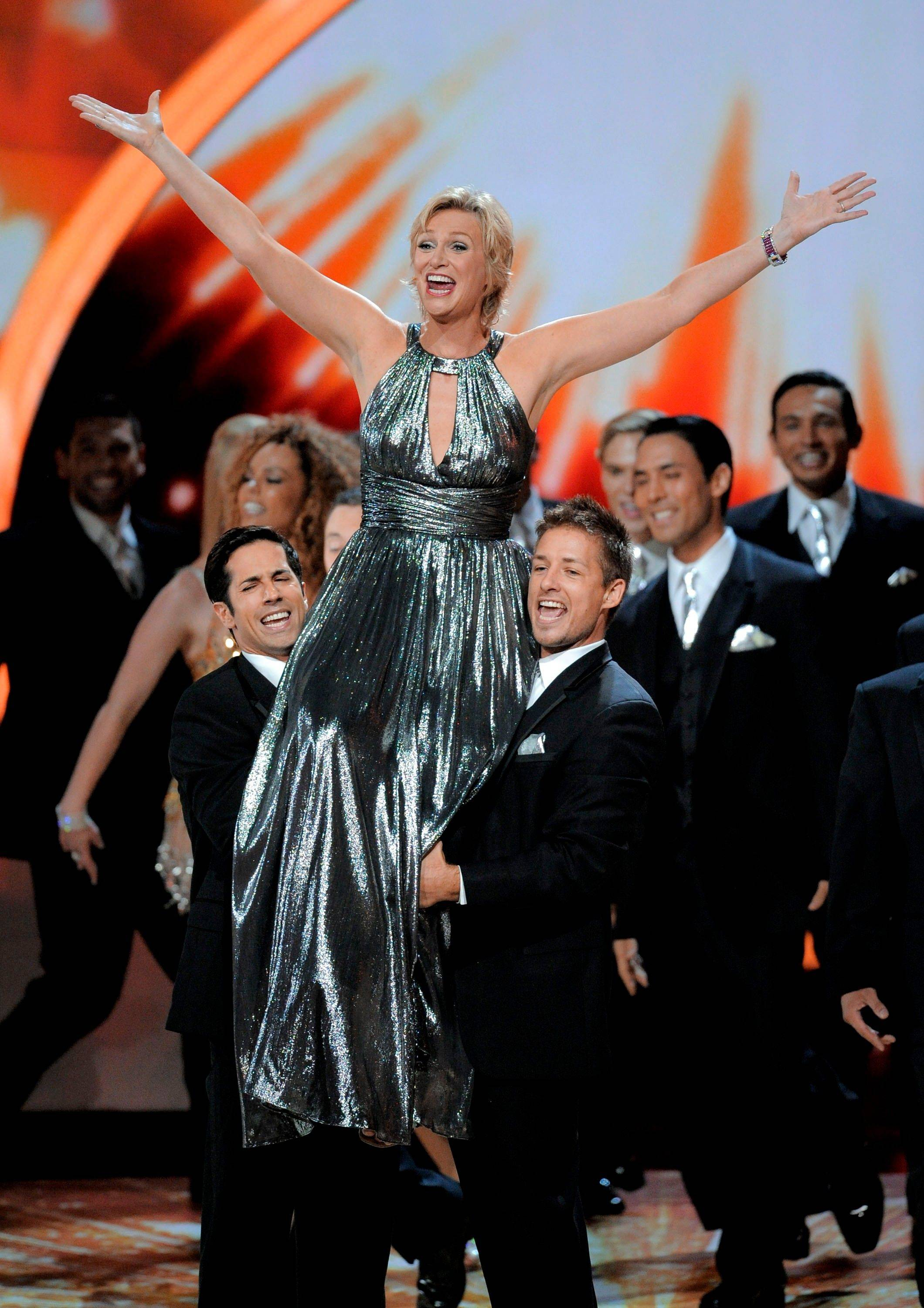 """Glee"" star and Emmy host Jane Lynch kicks off the show at the 63rd Primetime Emmy Awards on Sunday in Los Angeles."