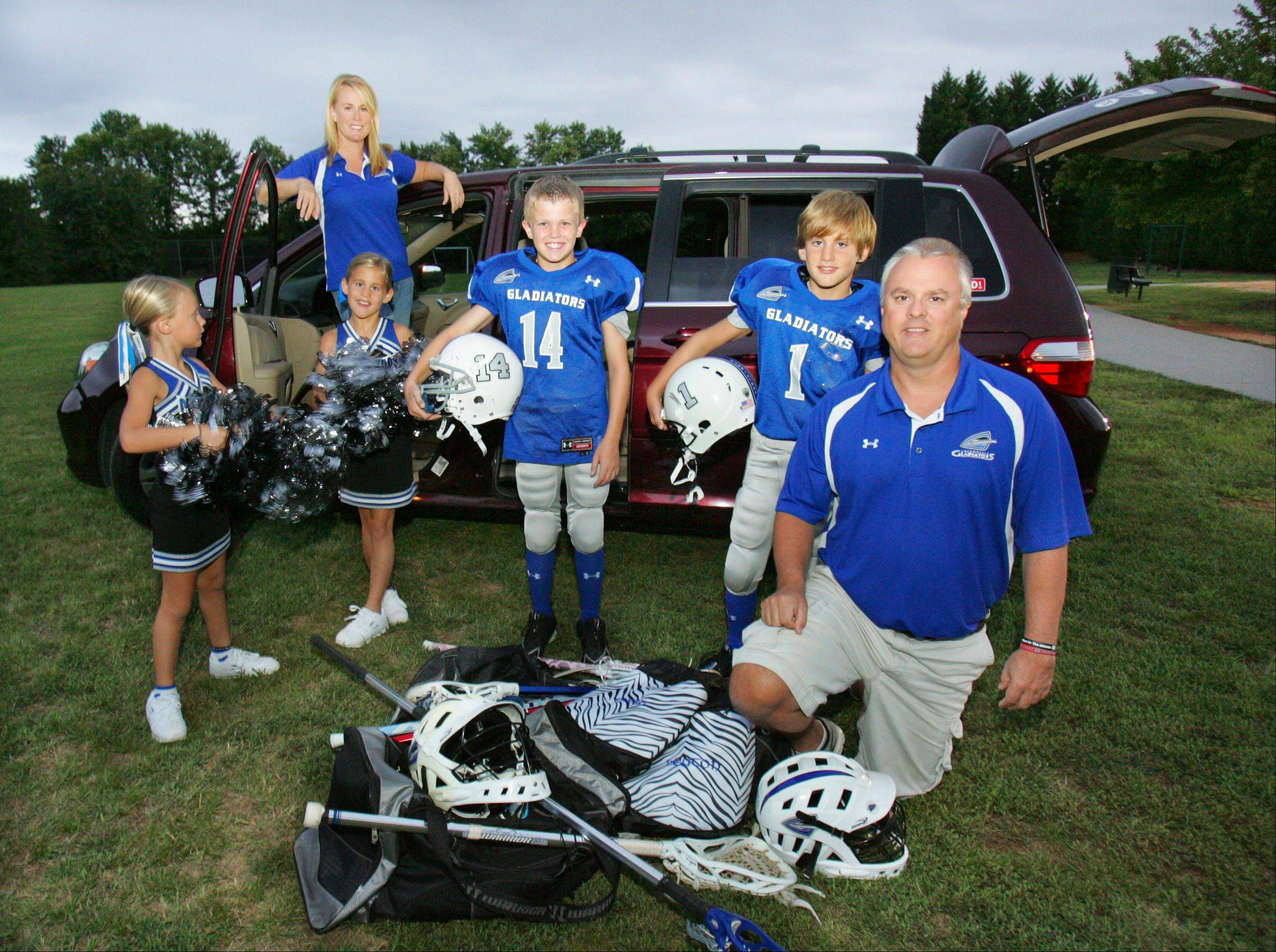 The Stevenson family uses aminivan to transport their children and friends to games in Greer, S.C. Front row, from left to right, are: Peyton Stevenson, 6; Emery Stevenson, 8; family friend Charlie Wright, 10; Cooper Stevenson, 10; and Bill Stevenson. Back row is Allison Stevenson. With three kids who need to get to soccer, lacrosse, football, cheer and swim team — not to mention school — Allison Stevenson says her eight-seater minivan is crucial for carpooling.