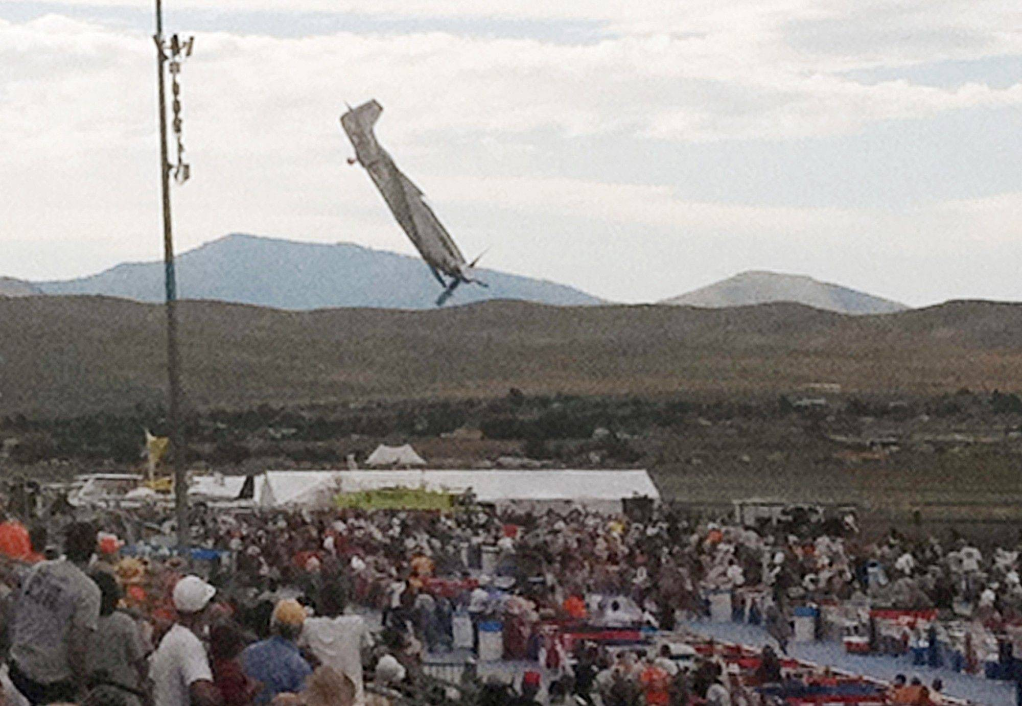 A P-51 Mustang airplane approaches the ground right before crashing during an air show Friday in Reno, Nev. The vintage World War II-era fighter plane piloted by Jimmy Leeward plunged into the grandstands during the popular annual air show.