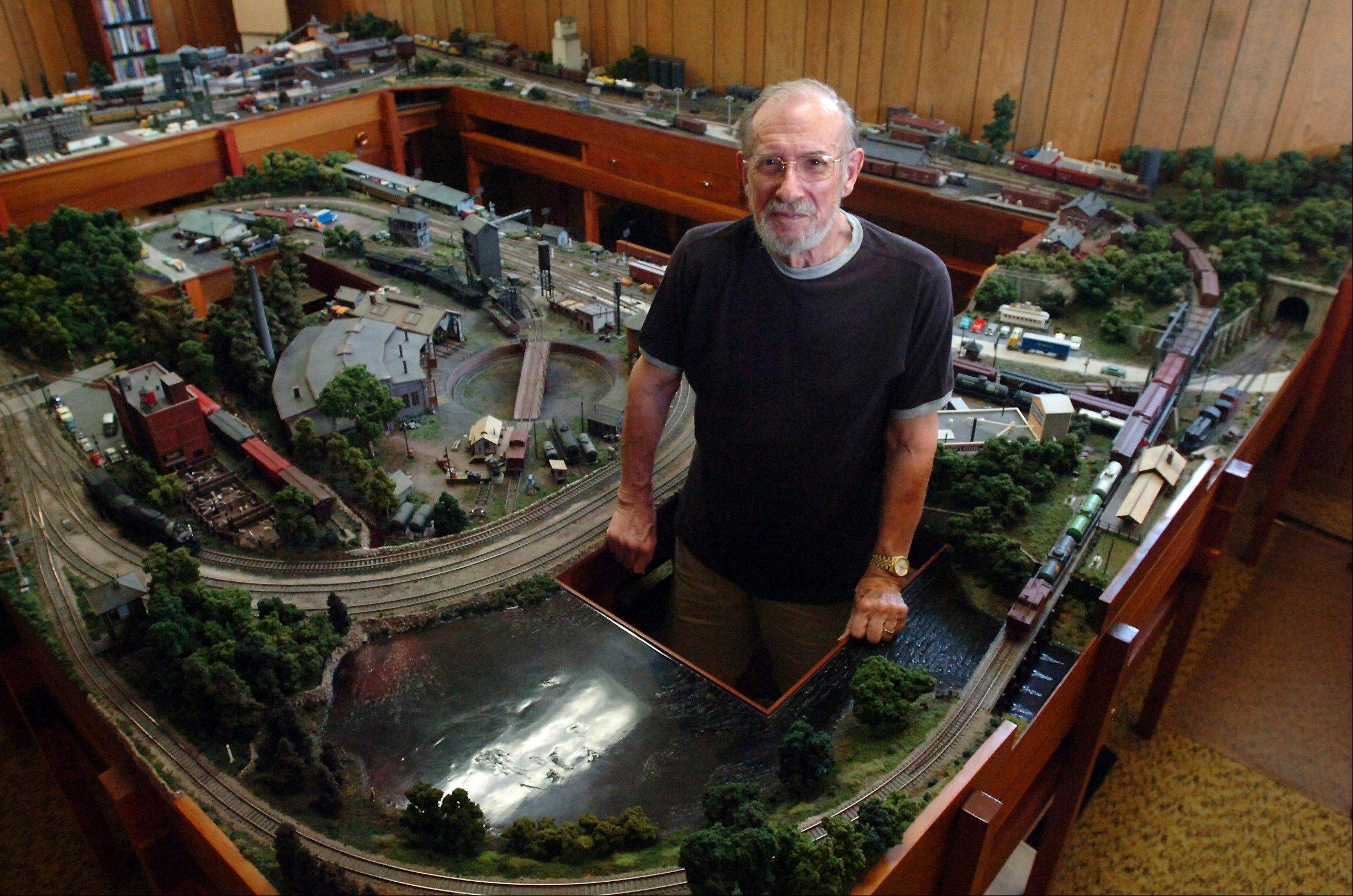 Model railroader Jerry McRoberts stands inside his HO gauge layout at his home in Charleston, Ill. (AP Photo/Journal Gazette, Ken Trevarthan)