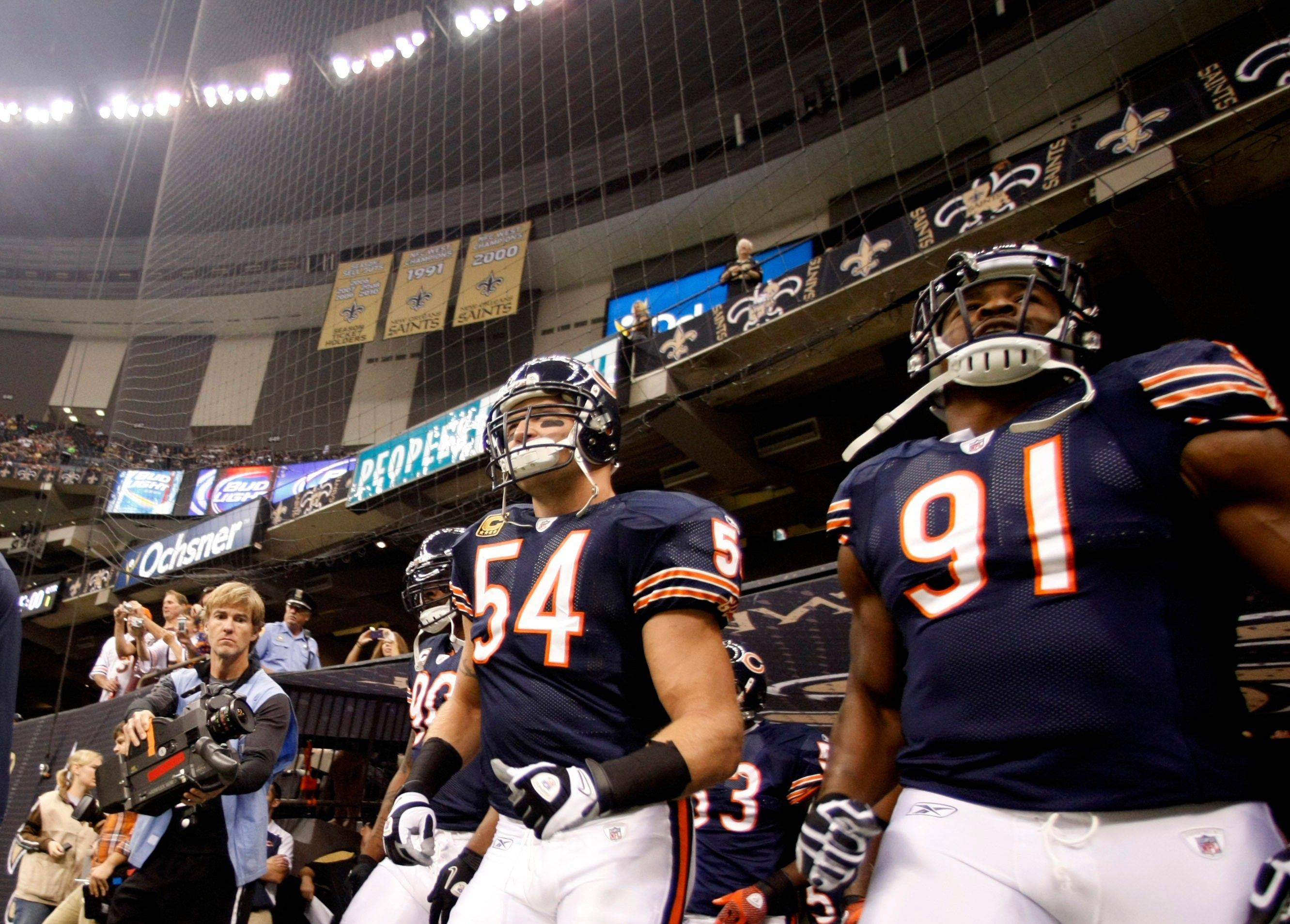 Chicago Bears middle linebacker Brian Urlacher (54) takes to the field with defensive end Julius Peppers (90) and defensive tackle Amobi Okoye (91) before the start of an NFL football game against the New Orleans Saints at the Louisiana Superdome in New Orleans, Sunday.