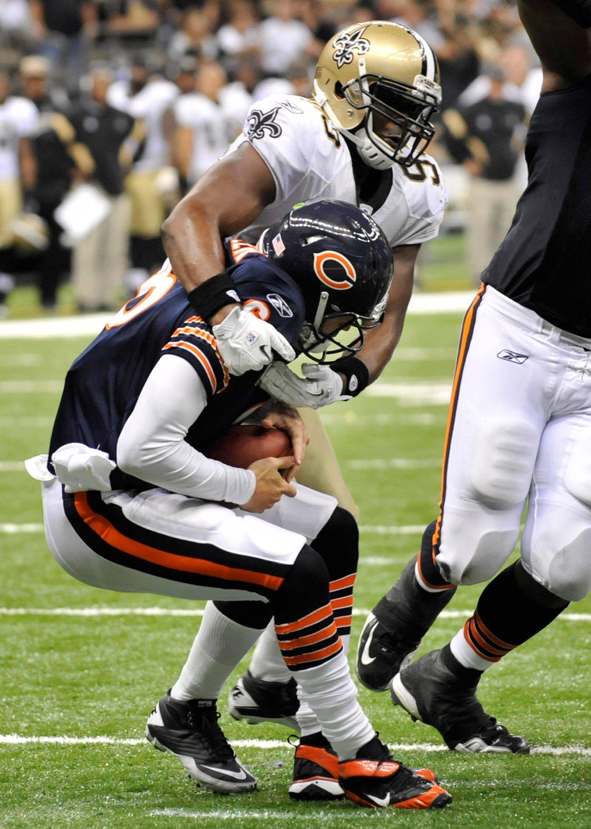 Bears quarterback Jay Cutler is sacked by Saints defensive end Junior Galette during the fourth quarter Sunday in New Orleans.
