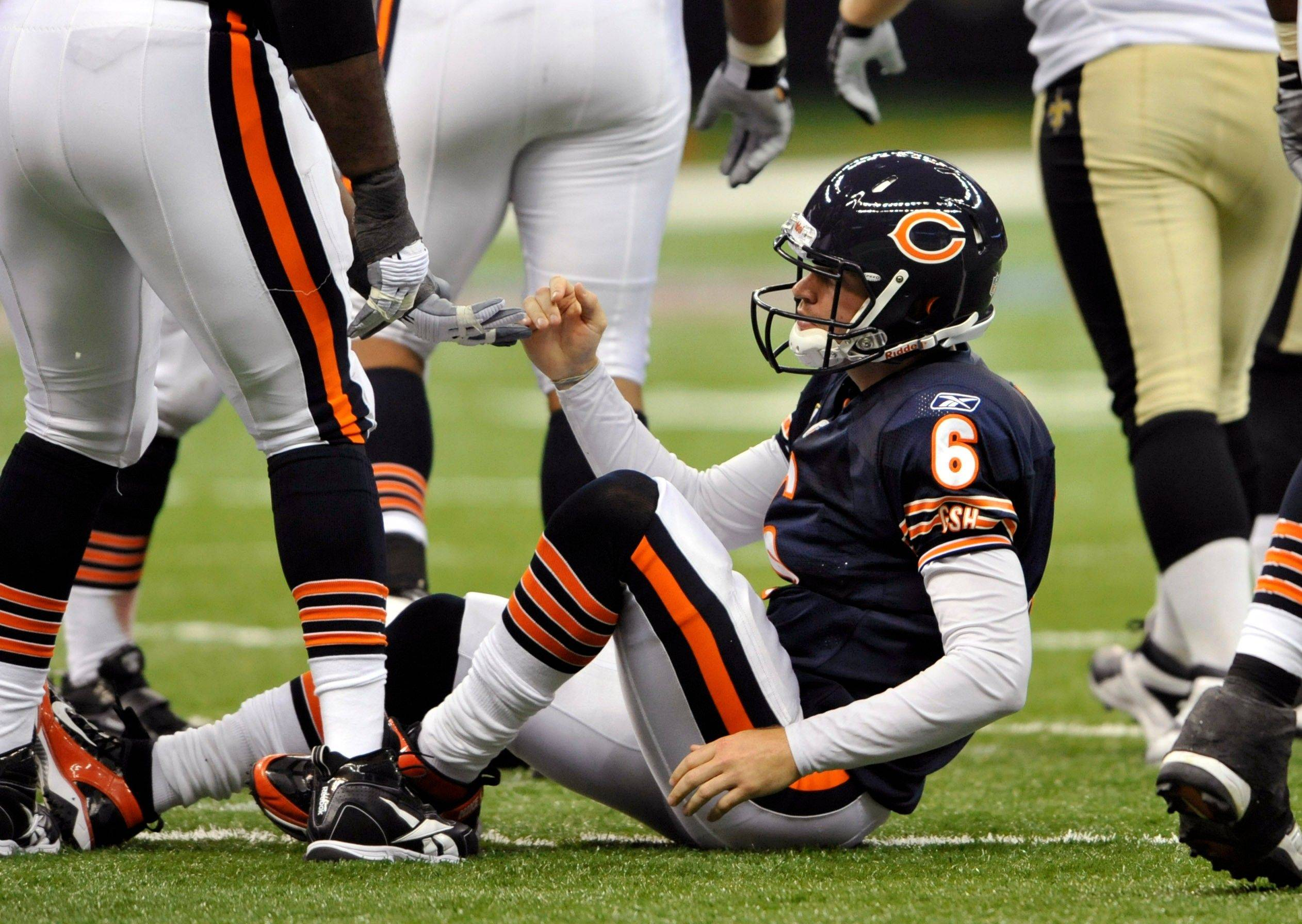 Chicago Bears quarterback Jay Cutler is helped up after being sacked during the fourth quarter of an NFL football game against the New Orleans Saints at the Louisiana Superdome in New Orleans, Sunday, Sept. 18, 2011. The Saints won 30-13.