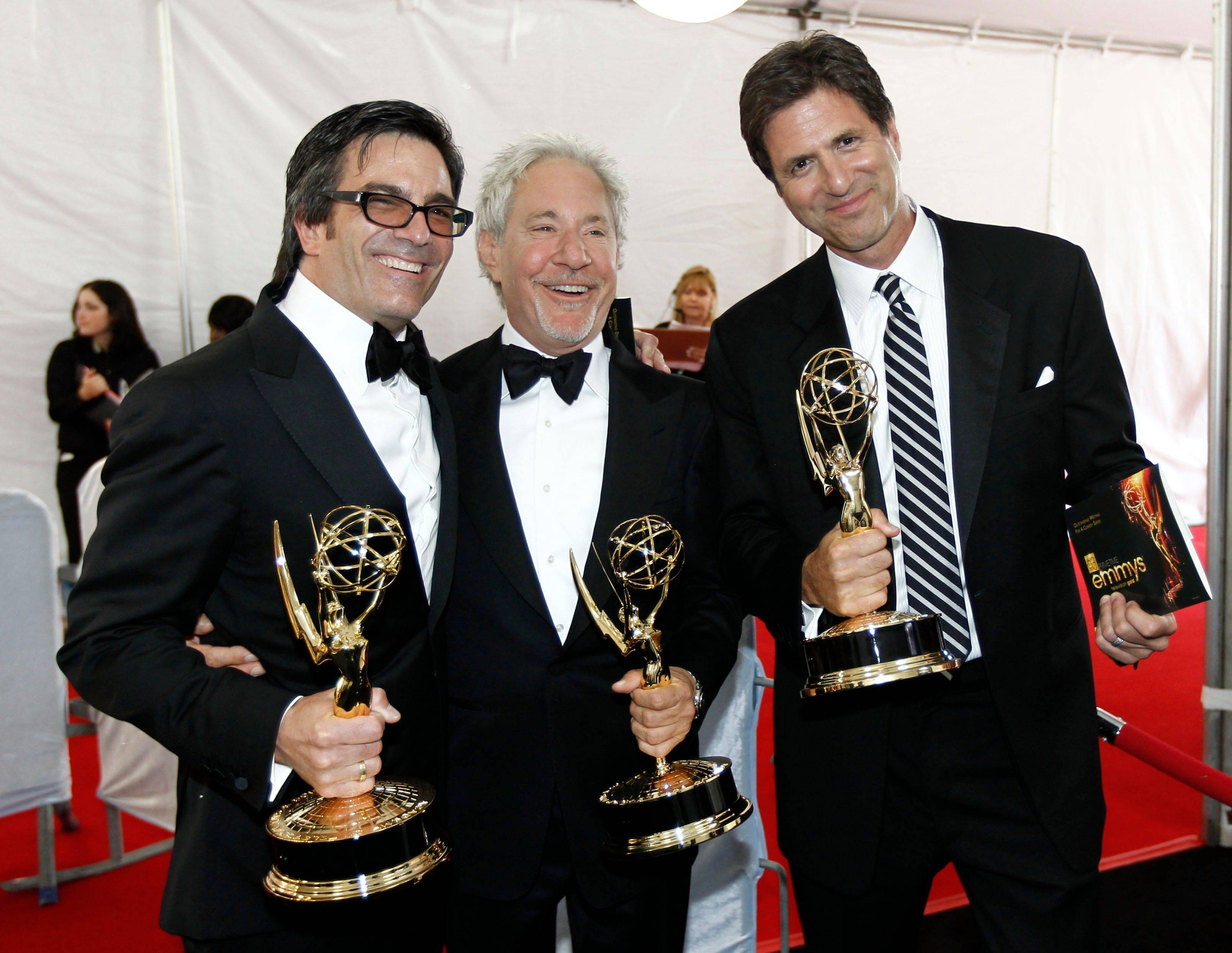 Director Michael Alan Spiller, writer Jeffrey Richman, and writer Steve Levitan pose backstage with their awards for outstanding directing for a comedy series and outstanding writing for a comedy series.