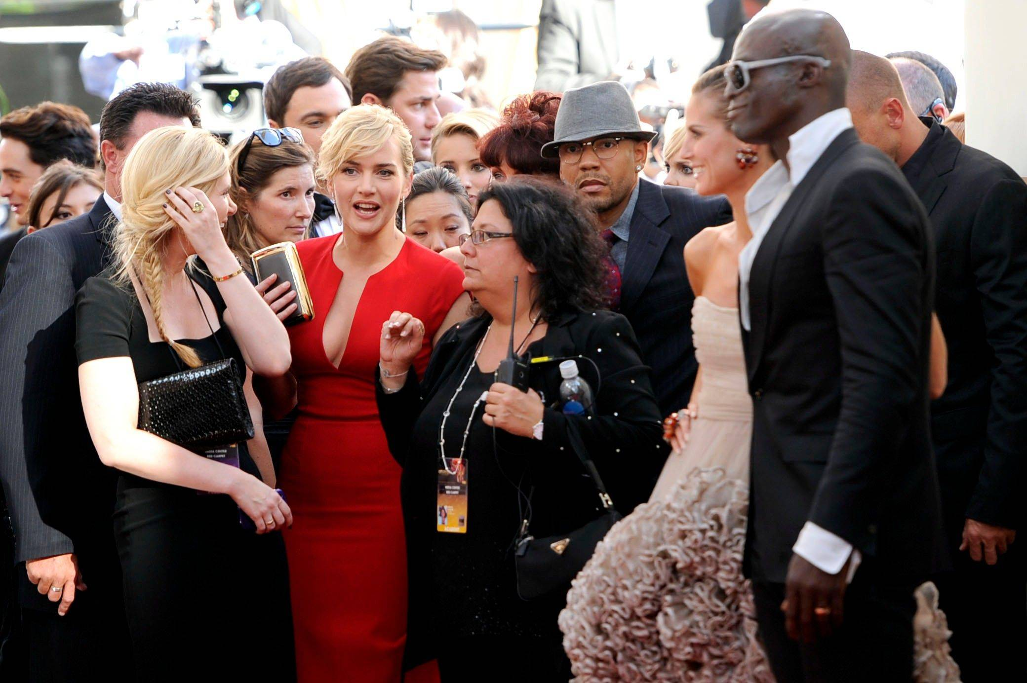 From left, Kate Winslet, Heidi Klum, and Seal get caught in the logjam on the Emmy red carpet.