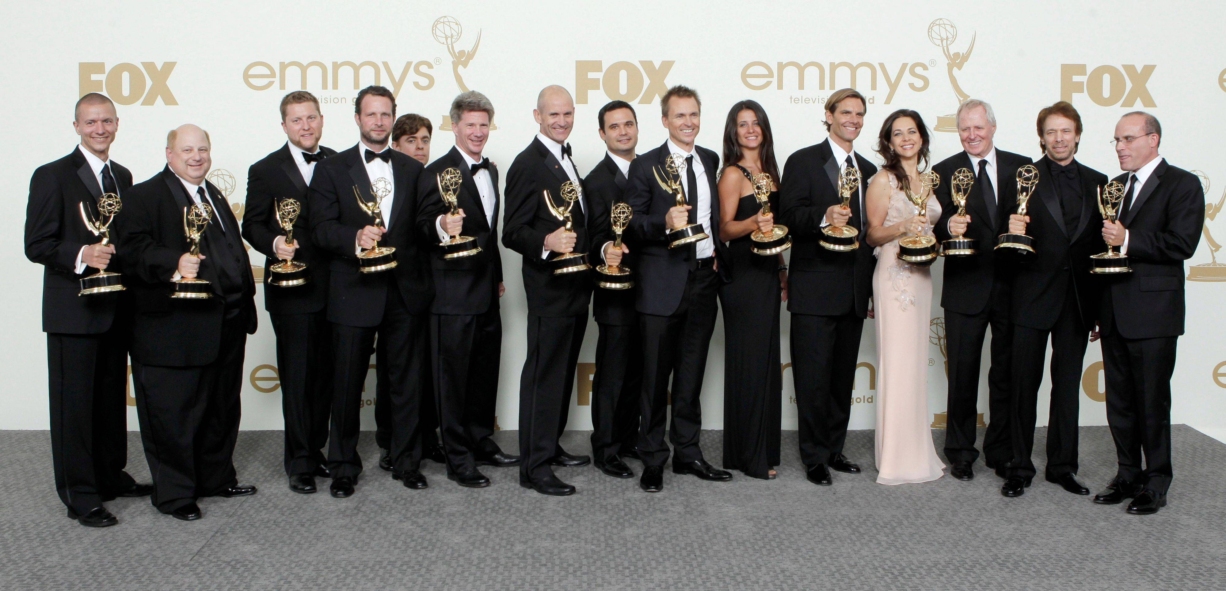 """The Amazing Race"" producers and host hold Emmys for best reality-competition program backstage."