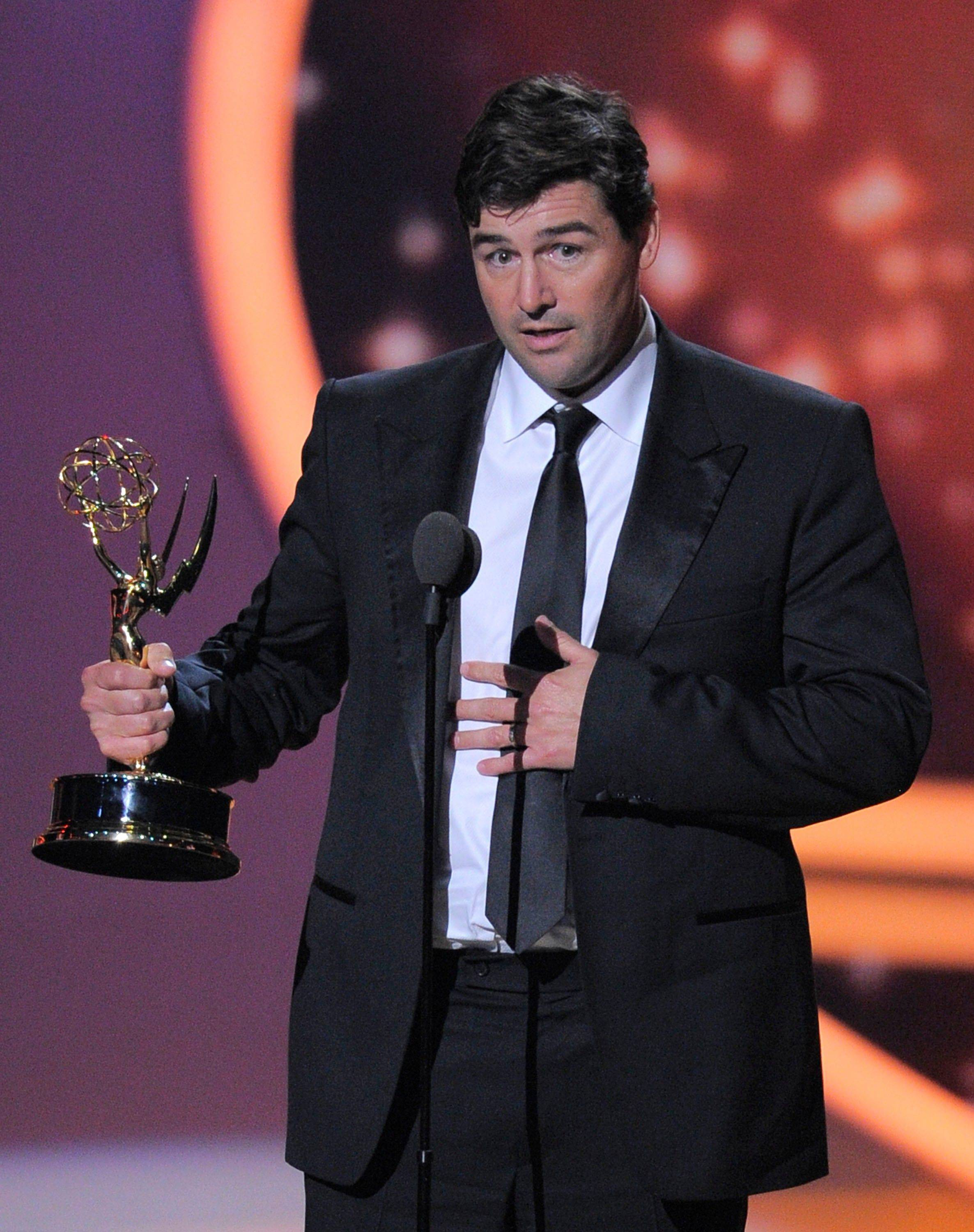 "Kyle Chandler accepts the award for outstanding lead actor in a drama series for ""Friday Night Lights."" ""I knew for a fact I would not be standing here. I did not write anything and now I'm starting to worry,"" said Chandler, who also beat out Steve Buscemi of ""Boardwalk Empire."""