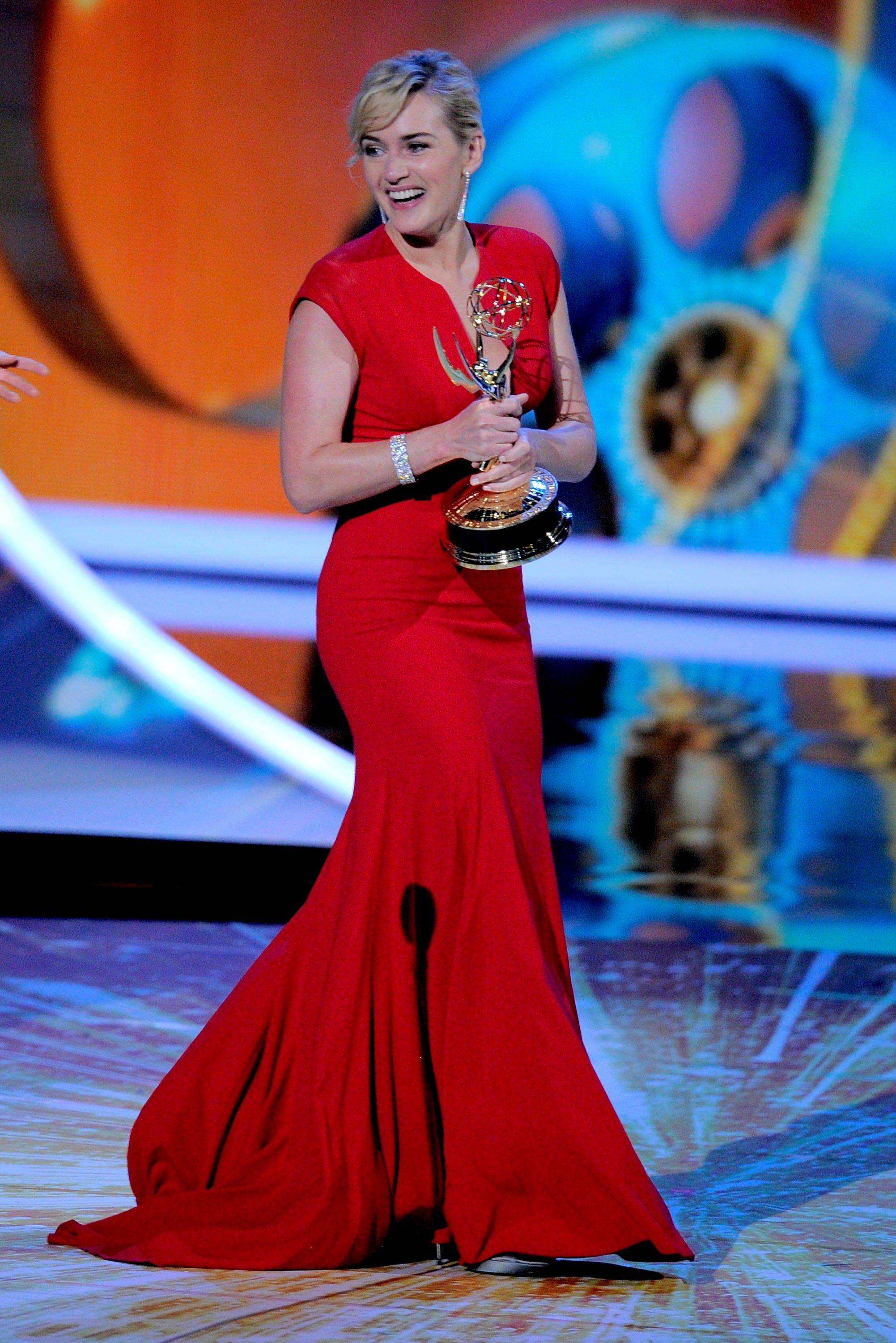 "Kate Winslet accepts the award for outstanding lead actress in a mini-series or movie for ""Mildred Pierce."""
