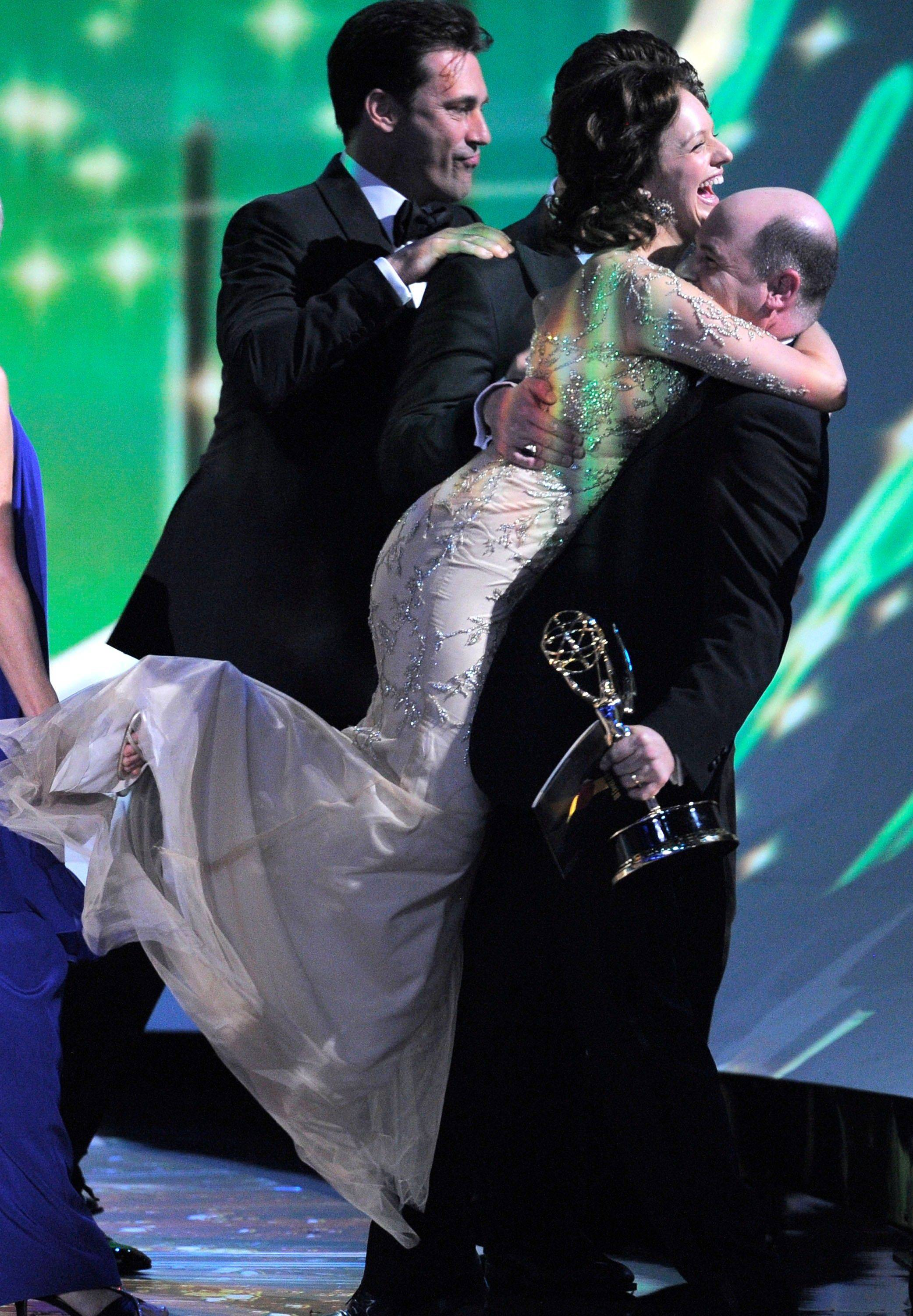 "Elisabeth Moss hugs ""Mad Men"" creator Matthew Weiner after accepting the award for outstanding drama series."