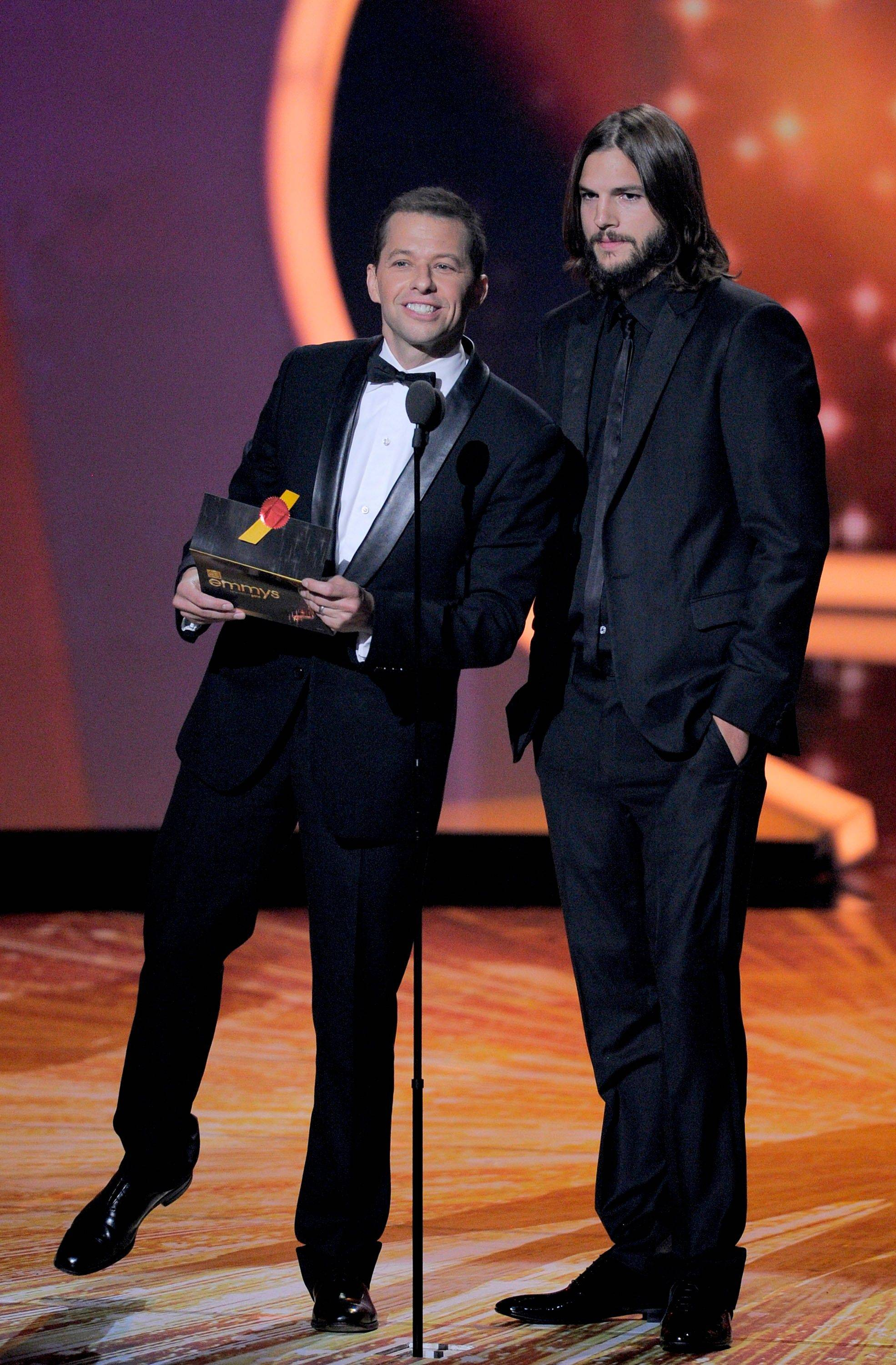 Jon Cryer, left, and Ashton Kutcher present the award for outstanding supporting actress in a drama series.