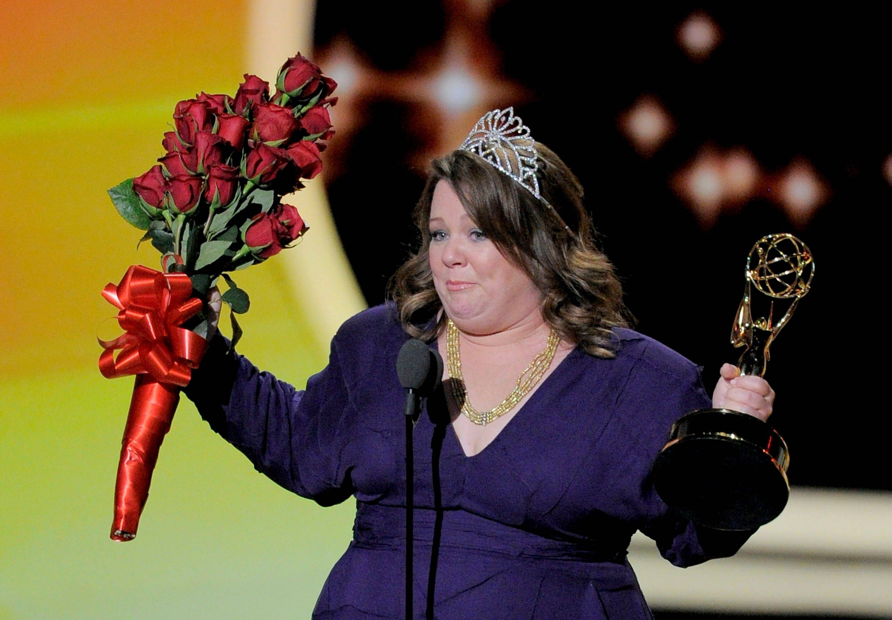 """Mike and Molly"" star Melissa McCarthy accepts the award for outstanding lead actress in a comedy series. A beaming McCarthy said, ""Holy smokes. Wow, it's my first and best pageant ever. I'm from Plainfield, Ill., and I'm standing here and it's kind of amazing."""