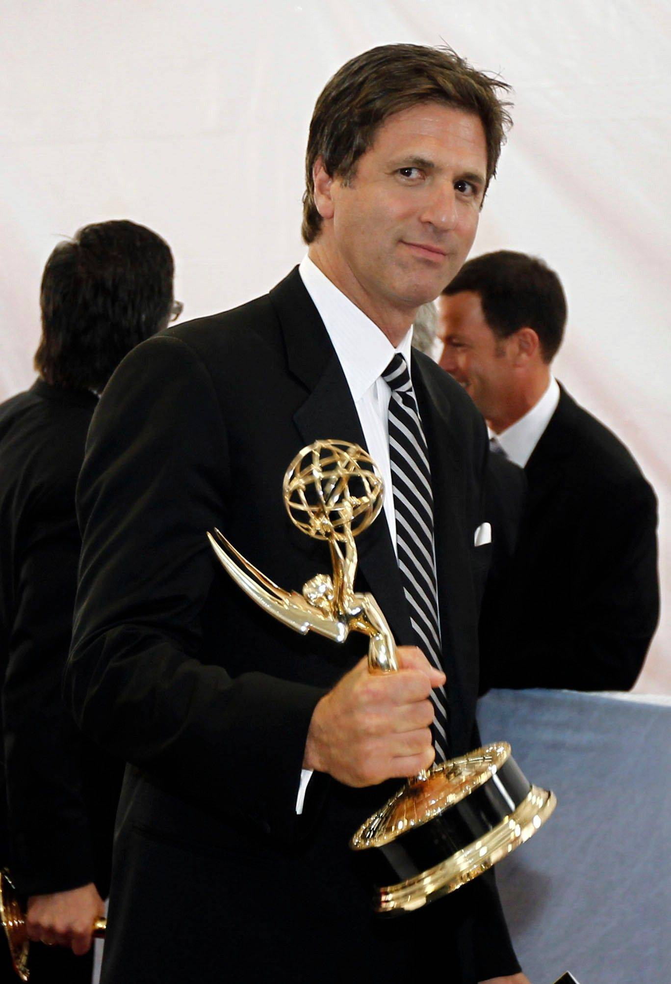 """Modern Family writer Steven Levitan is seen backstage with the award for outstanding writing for a comedy series."