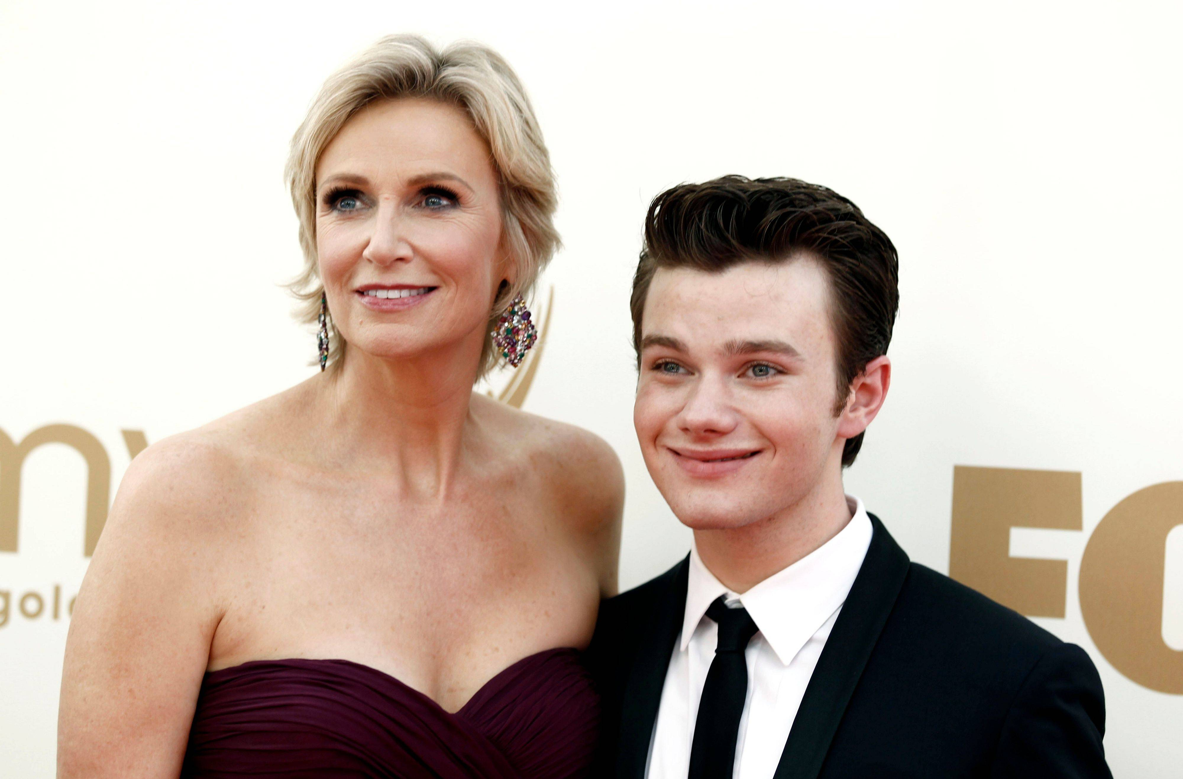 "Emmy host and nominee Jane Lynch poses on the red carpet with ""Glee"" co-star and nominee Chris Colfer."