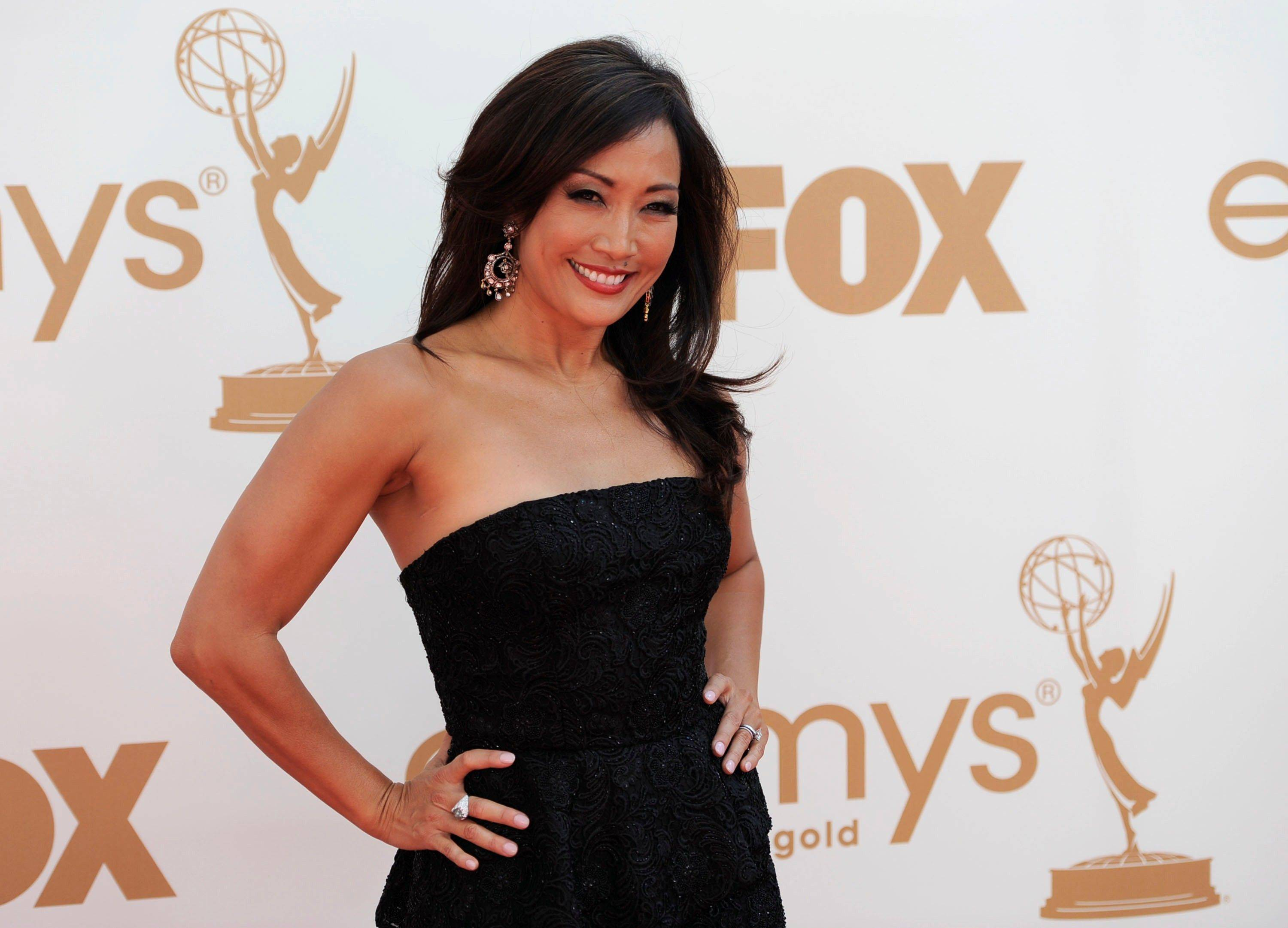 """Dancing with the Stars"" judge Carrie Ann Inaba also follows one of the evening's other trends with a dark strapless gown."