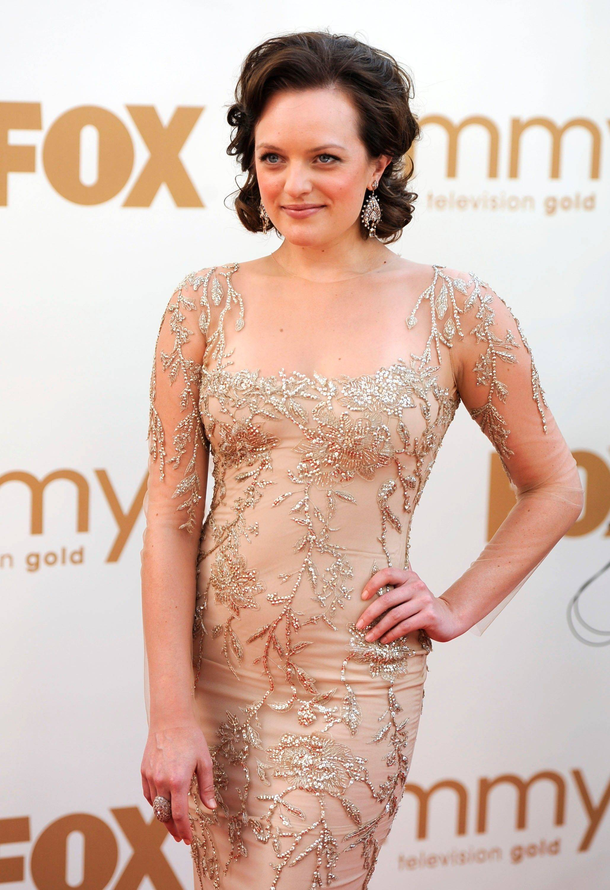 """Mad Men"" star Elisabeth Moss outshines her co-stars with this form-fitting old school Hollywood gown by Marchesa."