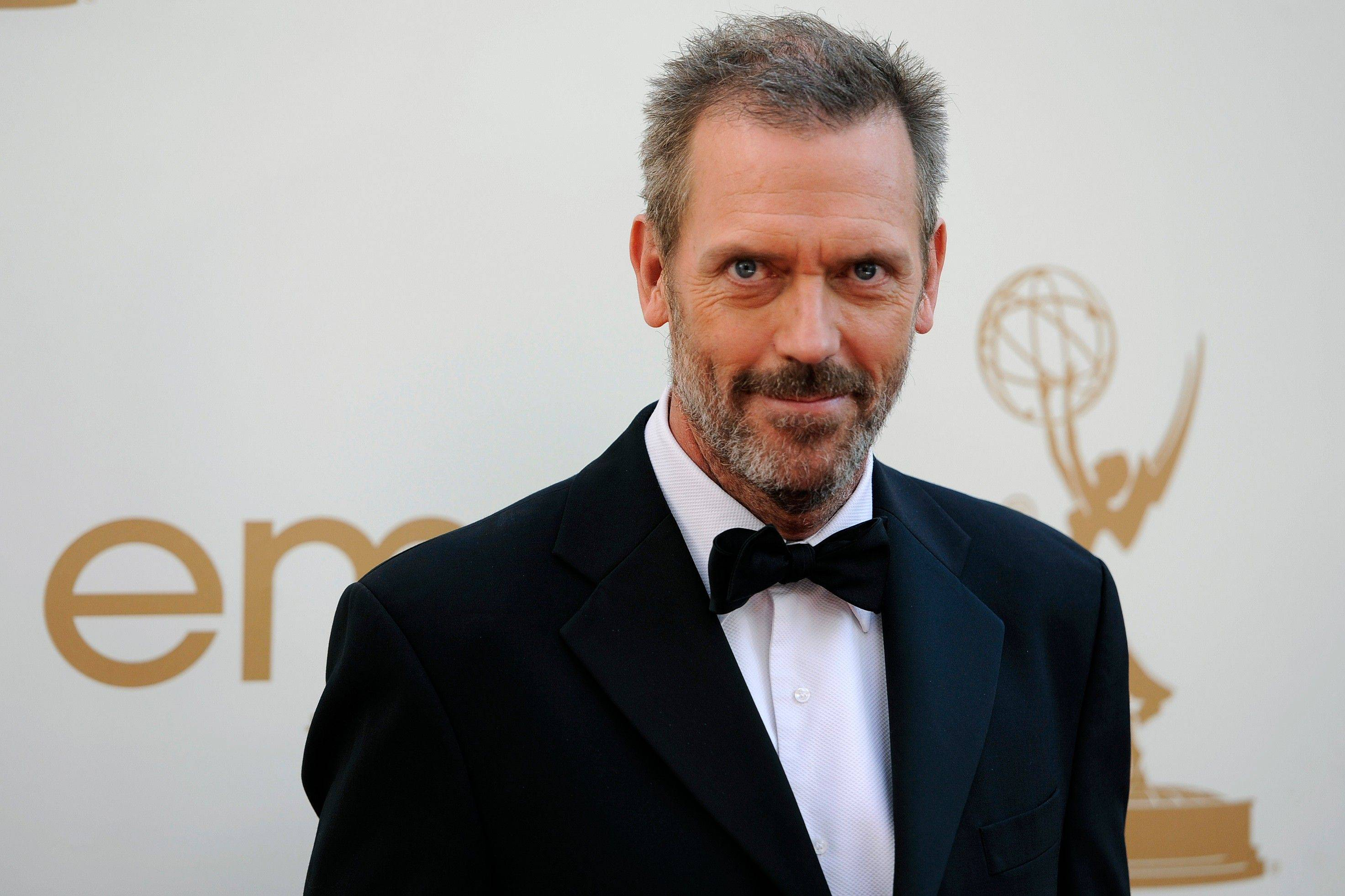 """House"" star Hugh Laurie makes his way into the ceremony."
