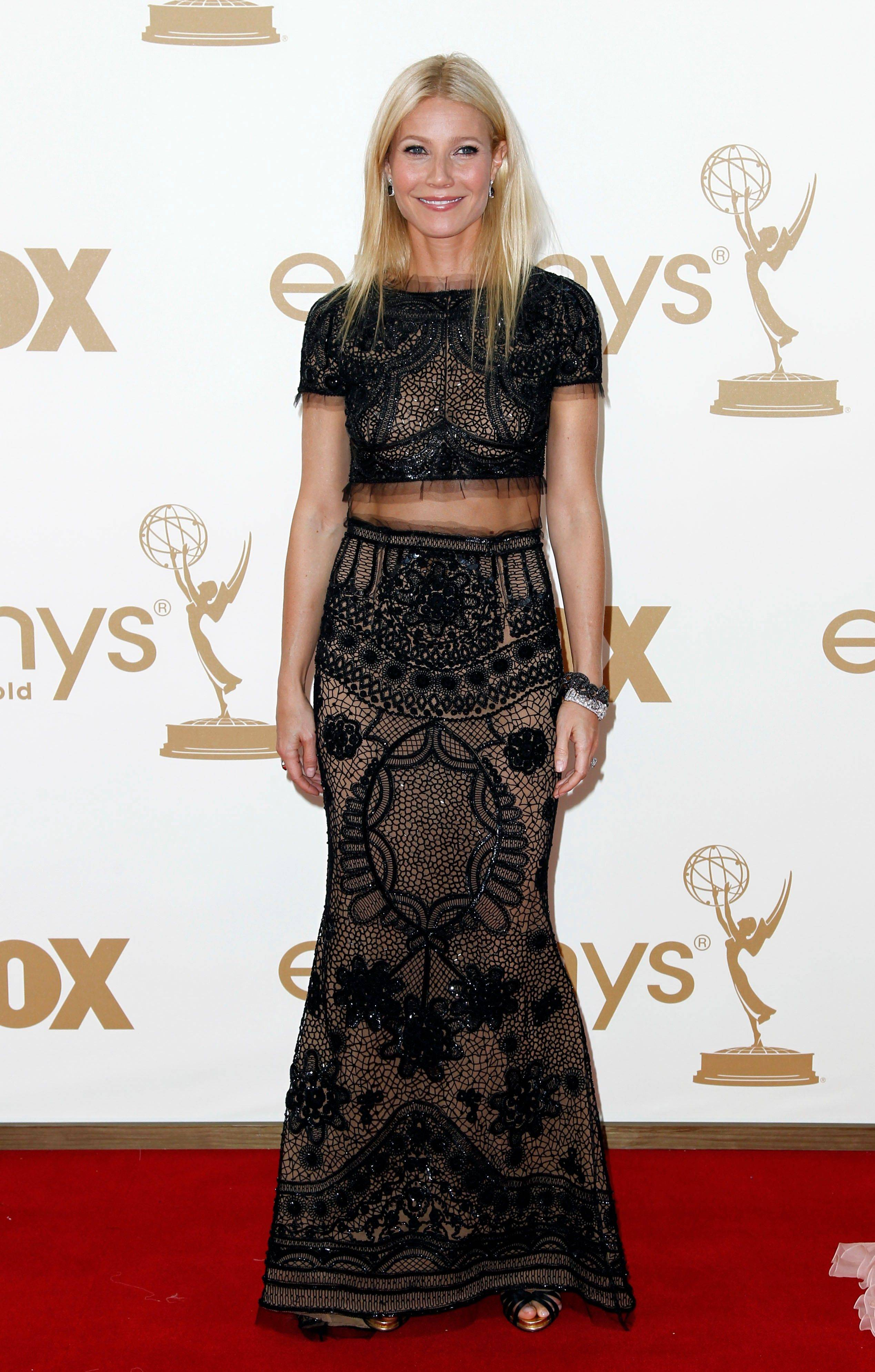 "Gwyneth Paltrow, who won an Emmy earlier in the week for her guest starring role on ""Glee"" wore this daring, sheer, belly baring design by Emilio Pucci."