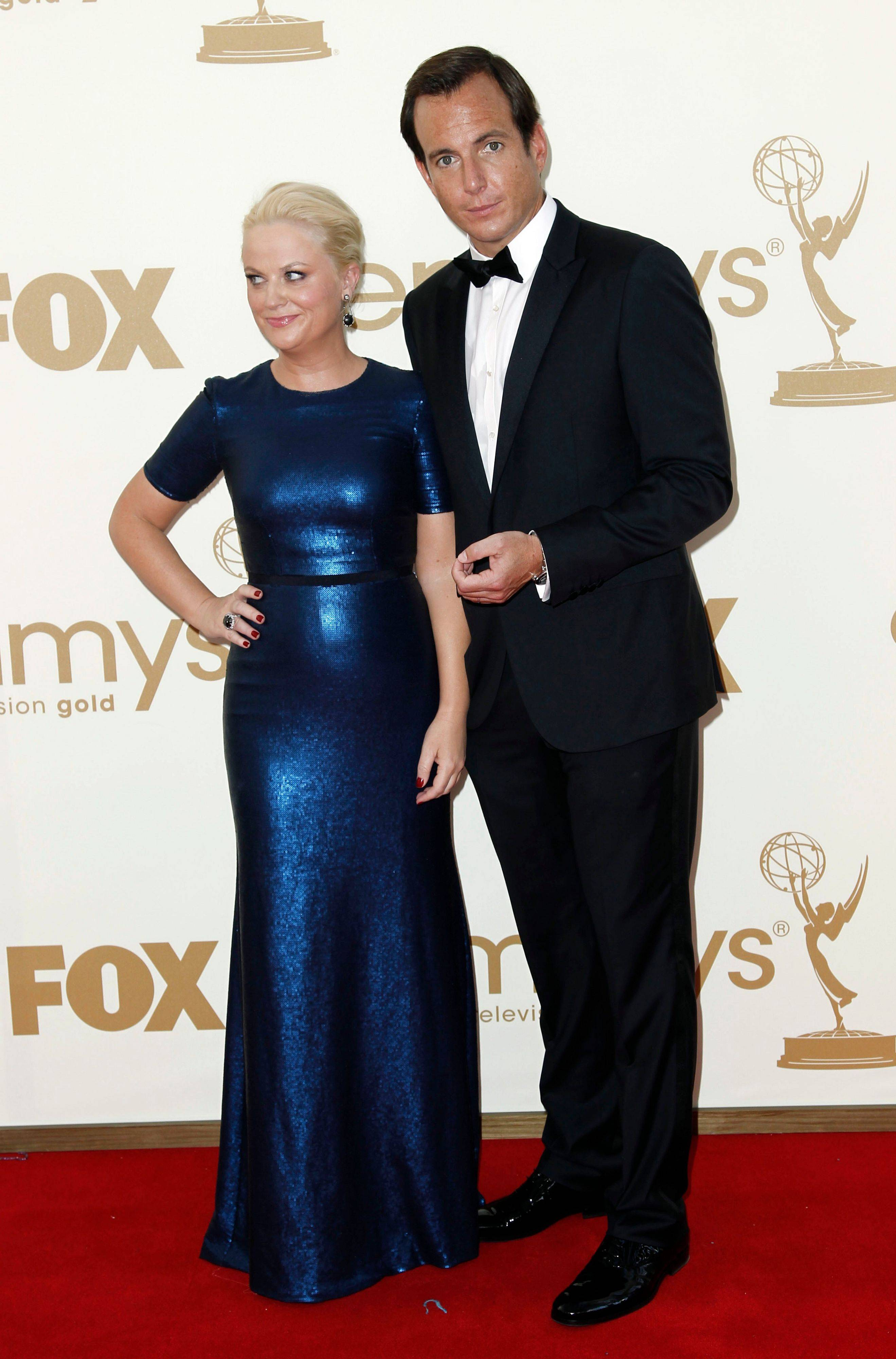 """Parks and Rec"" star Amy Poehler walk the red carpet with her husband Will Arnett, who's currently starring in ""Up All Night"" with Christina Applegate."