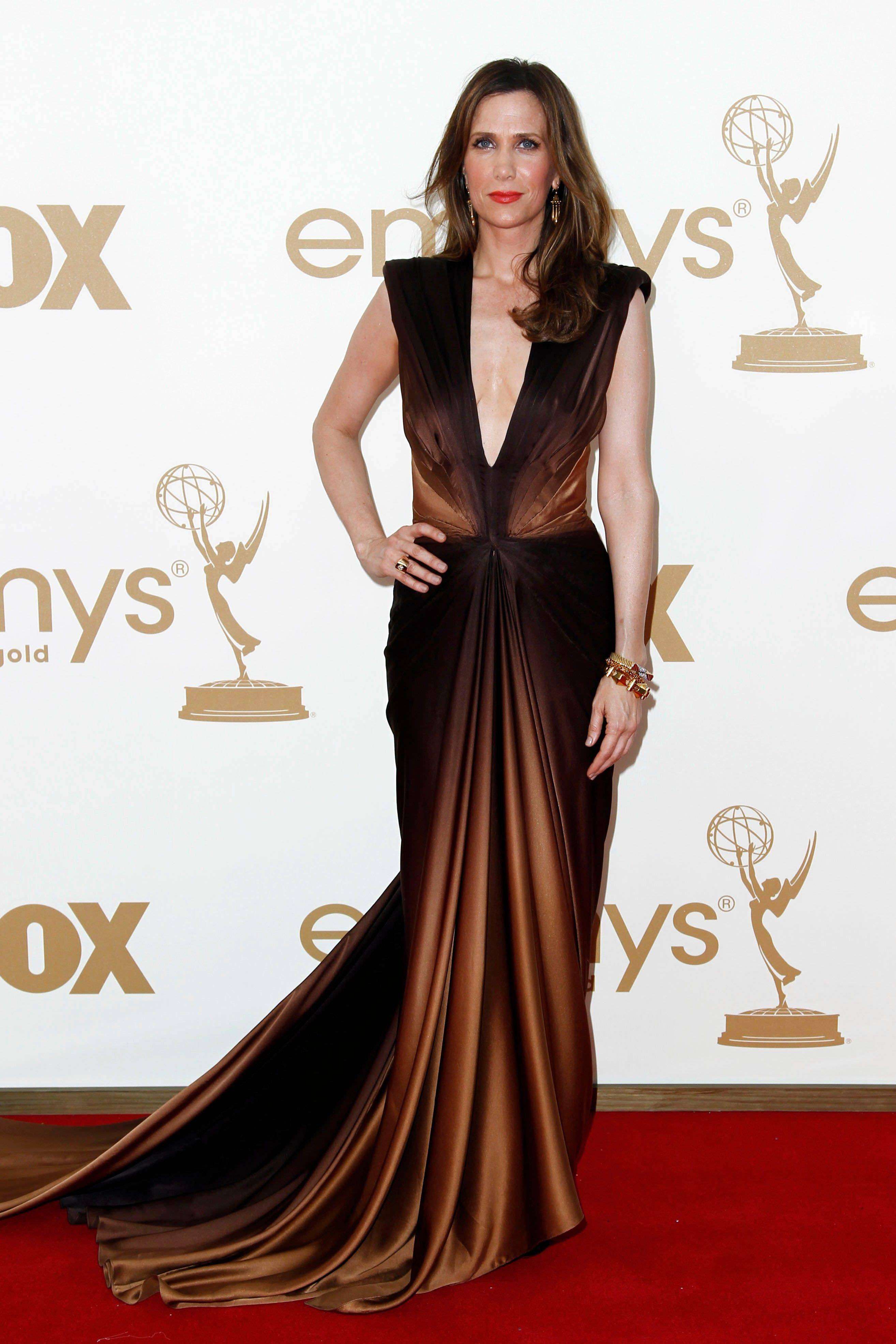 "Funny woman and ""Saturday Night Live"" star Kristen Wiig turns up the glam quotient in this daring gown."