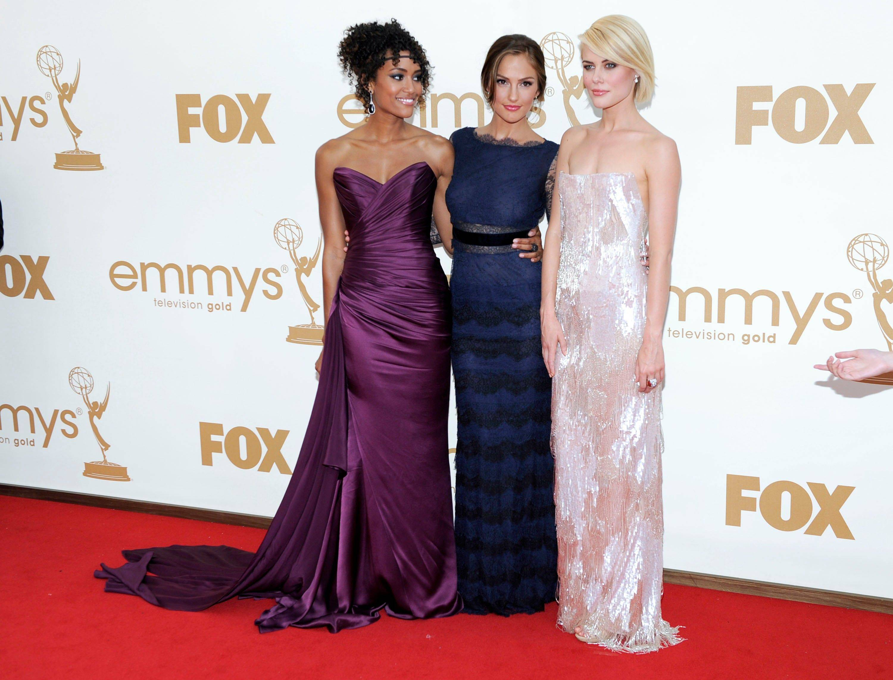 "The stars of the new ""Charlie's Angels"" from left, Annie Ilonzeh,Minka Kelly and Rachael Taylor show off their different fashion styles on the red carpet."