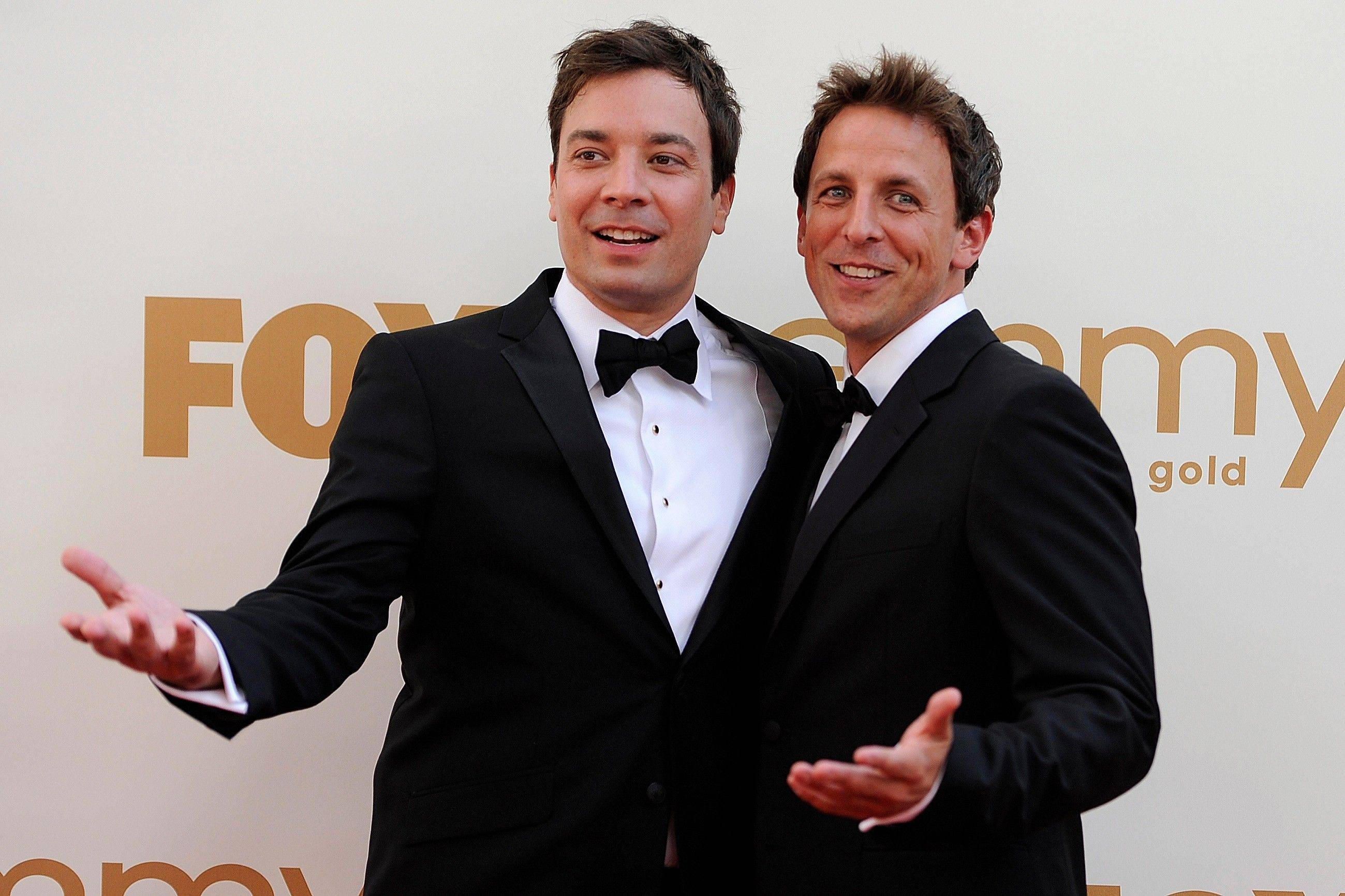 "Talk show host Jimmy Fallon and ""Saturday Night Live"" head writer Seth Meyers have a little fun on the red carpet."