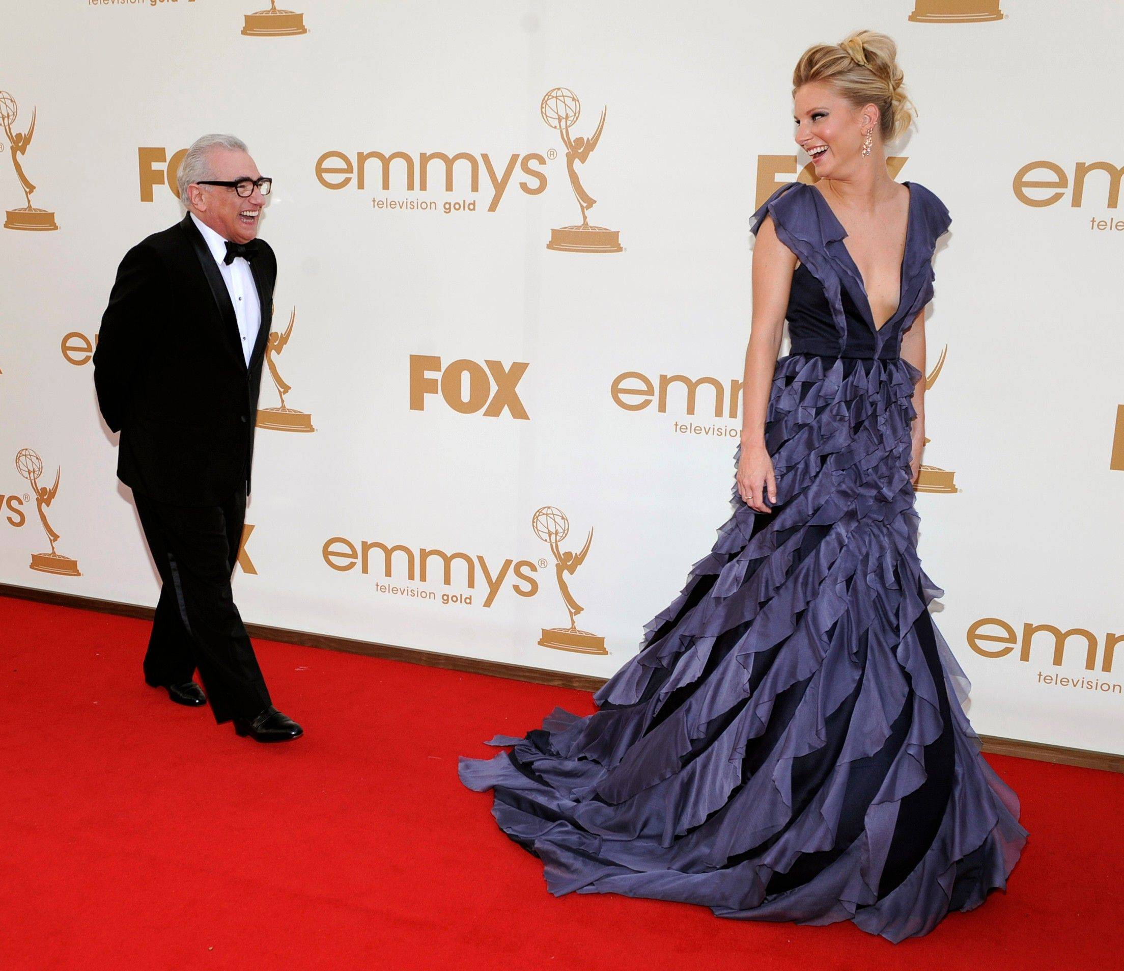 "Director Martin Scorsese shares a laugh with ""Glee"" star Heather Morris before heading into the ceremony."