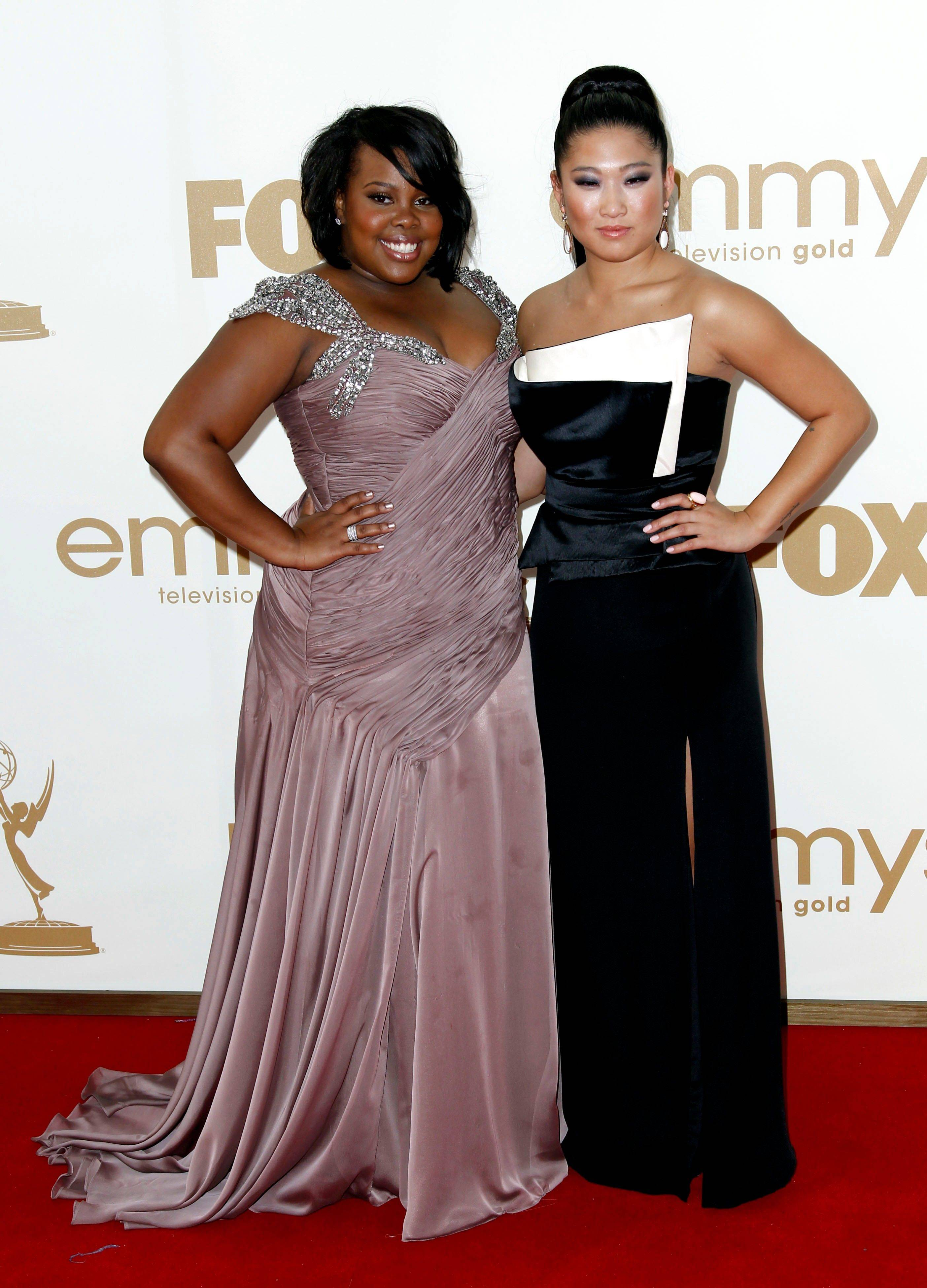 """Glee"" stars Amber Riley, left, and Jenna Ushkowitz look all grown up in their Emmy best."