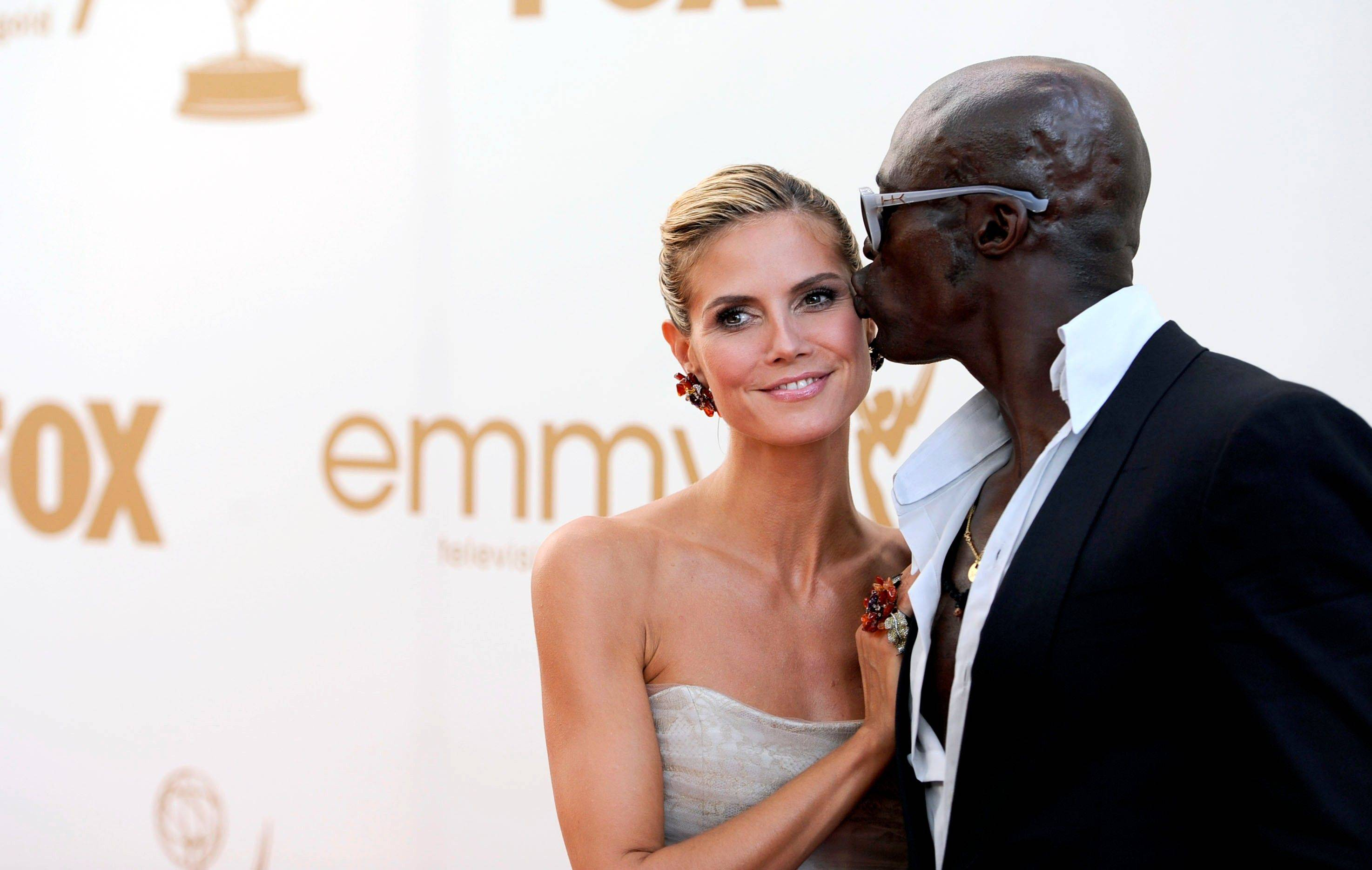Heidi Klum and Seal get a little playful on the red carpet.