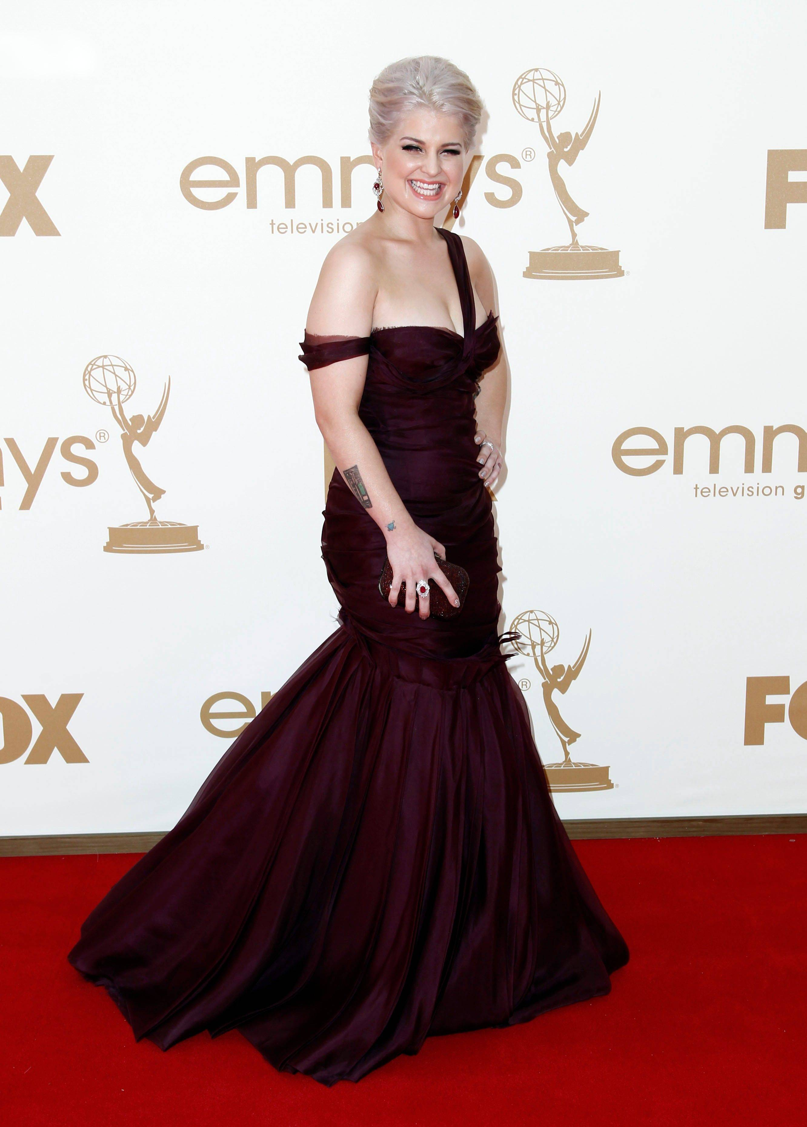Reality TV star Kelly Osbourne shows off a more sophisticated side in this dashing purple gown.