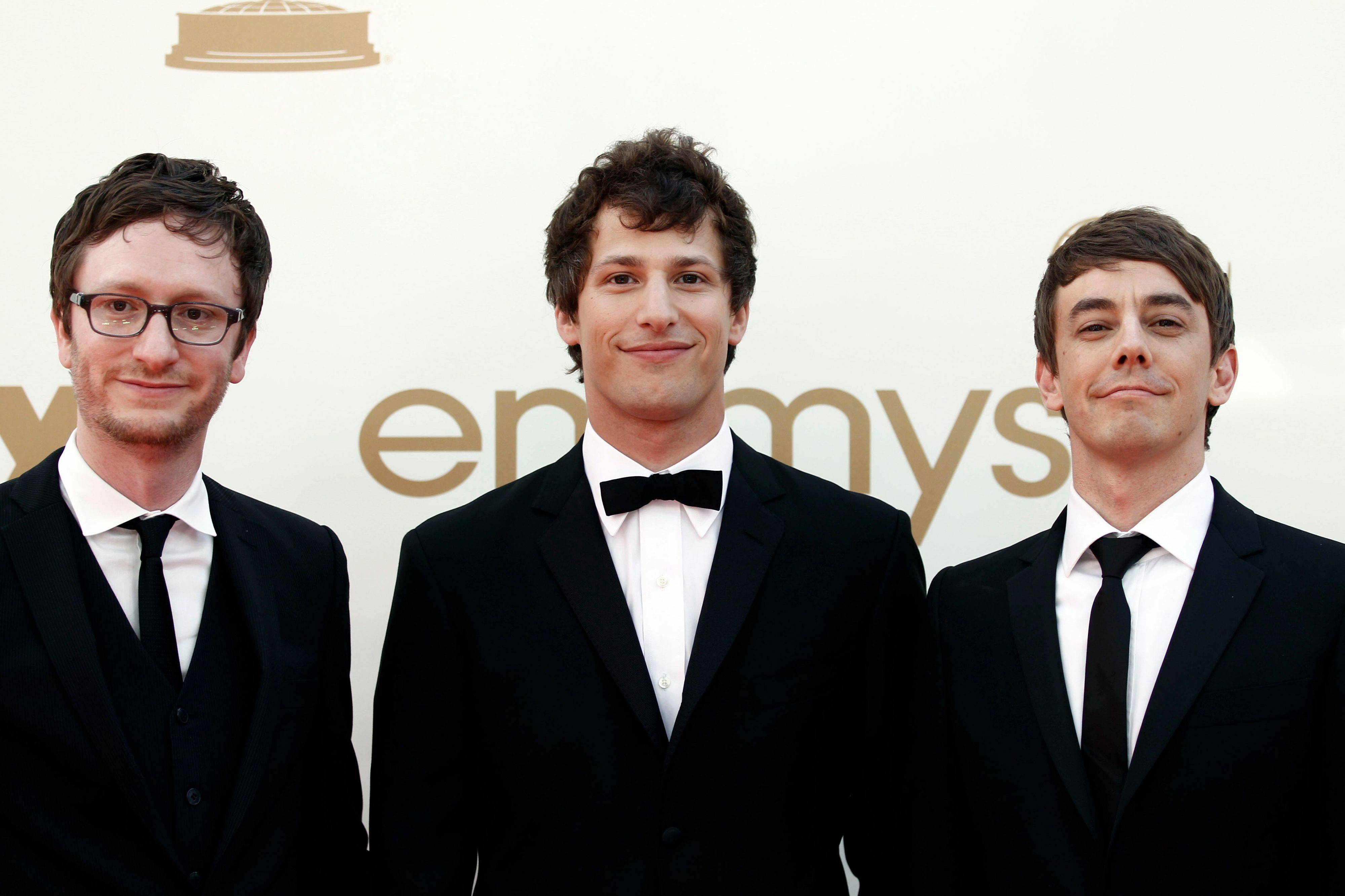 From left, Akiva Schaffer, Andy Samberg, and Jorma Taccone alka The Lonley Island walk the press line before the Emmy Awards. The trio was slated to perform during the ceremony.