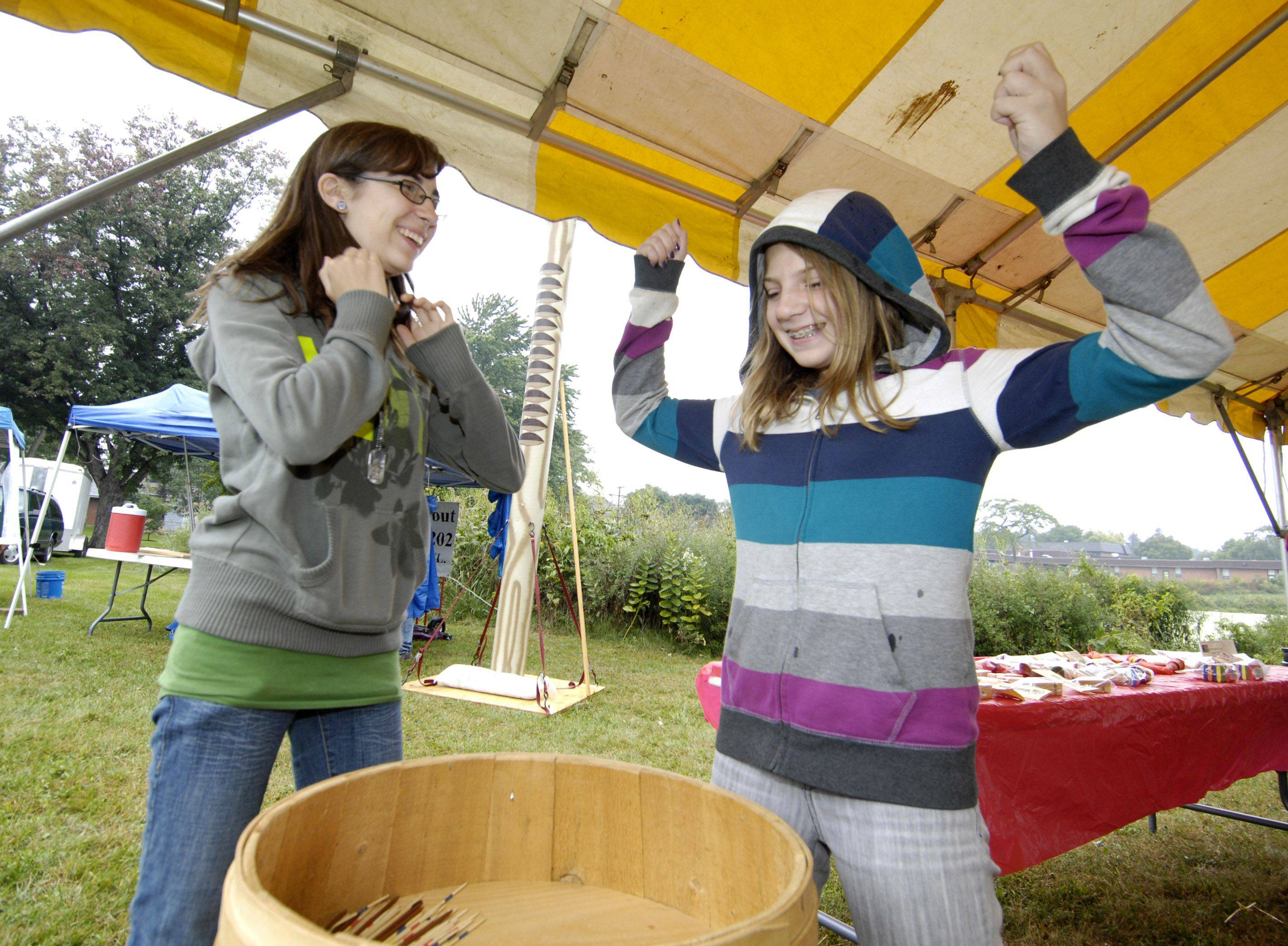 Zoe McNett, 15 and Alex Schneeberger, 12, of Lombard play jacks during Prairie Days at Terrace View Park in Lombard Sunday. The event was sponsored by the Lombard Park District and the Lombard Garden Club.