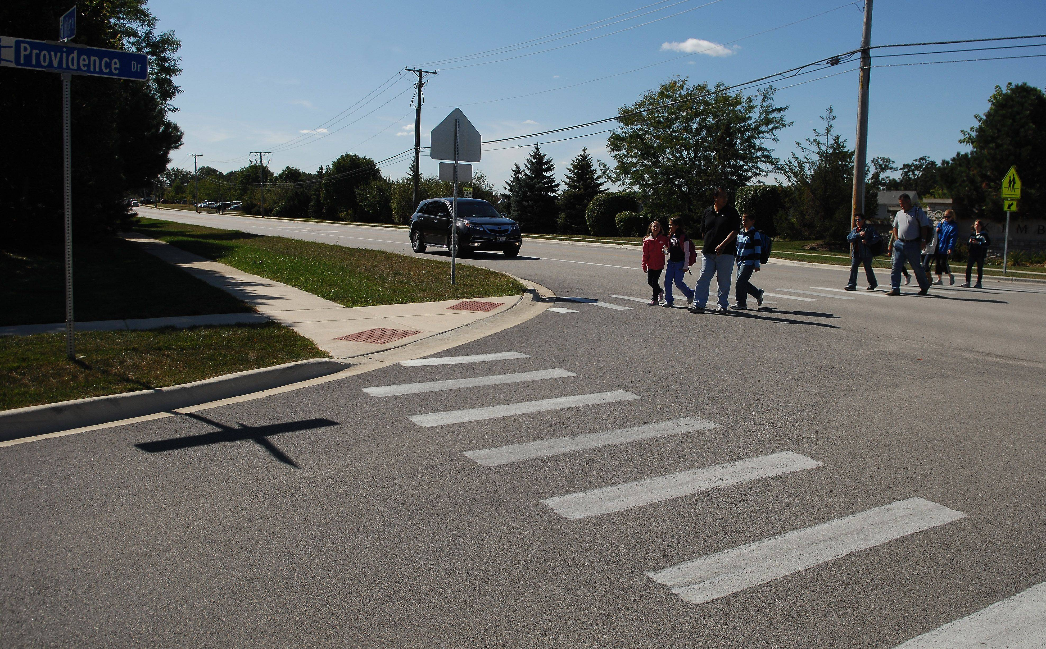 Carpentersville authorities are going to put yield signs by a crosswalk at Miller Road and Providence Drive near Liberty School. At least one parent says the signs will never be a substitute for the crossing guard who worked there for years and knew the children by name.