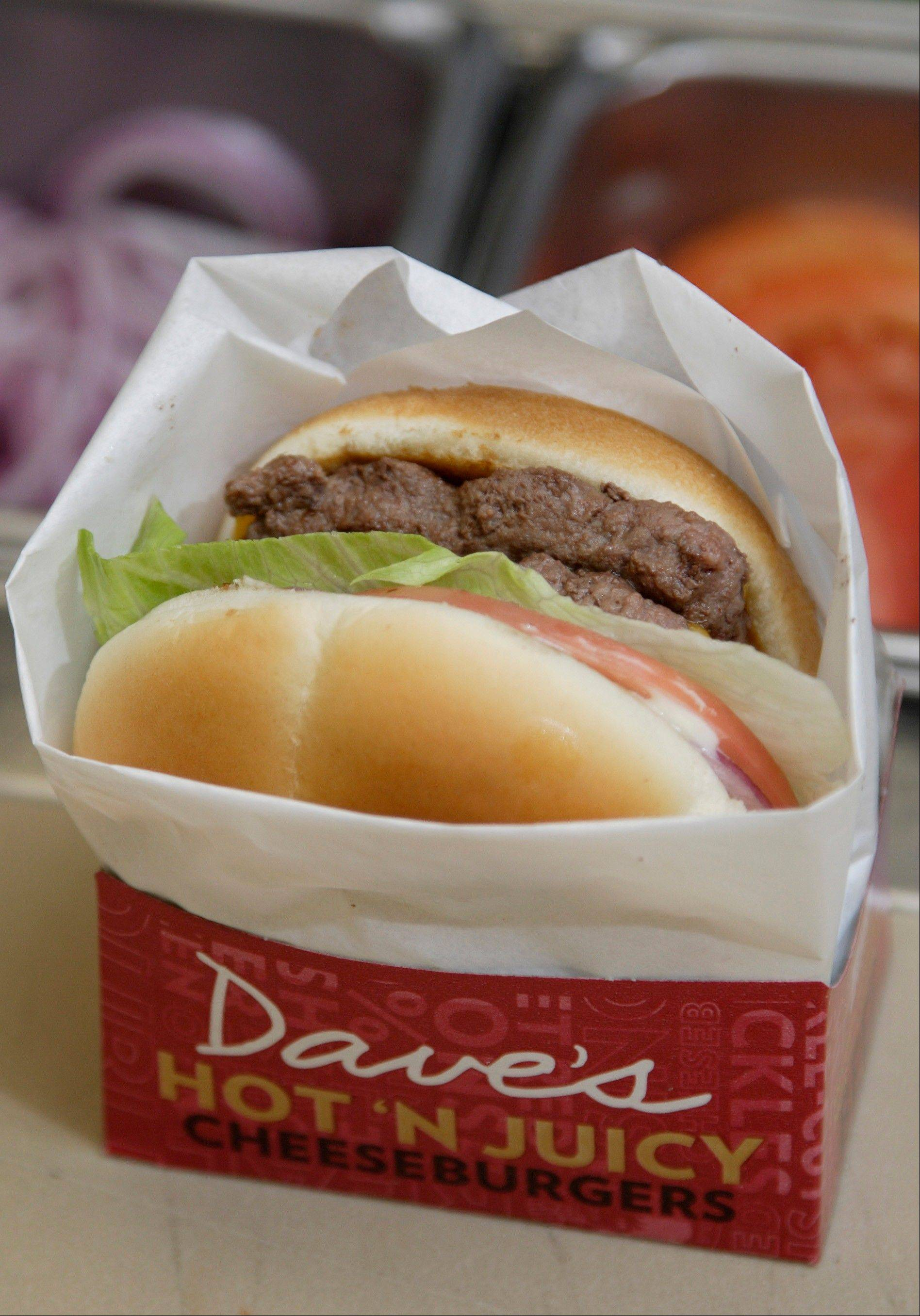 A new Dave's Hot 'N Juicy Cheeseburger is displayed in the Wendy's research and development laboratory at the company's international headquarters in Dublin, Ohio.