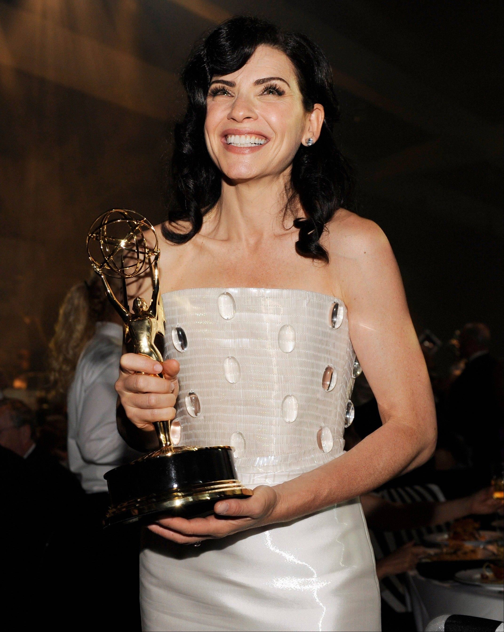 """The Good Wife"" cast member Julianna Margulies enjoys her Emmy win for best lead actress in a drama series."