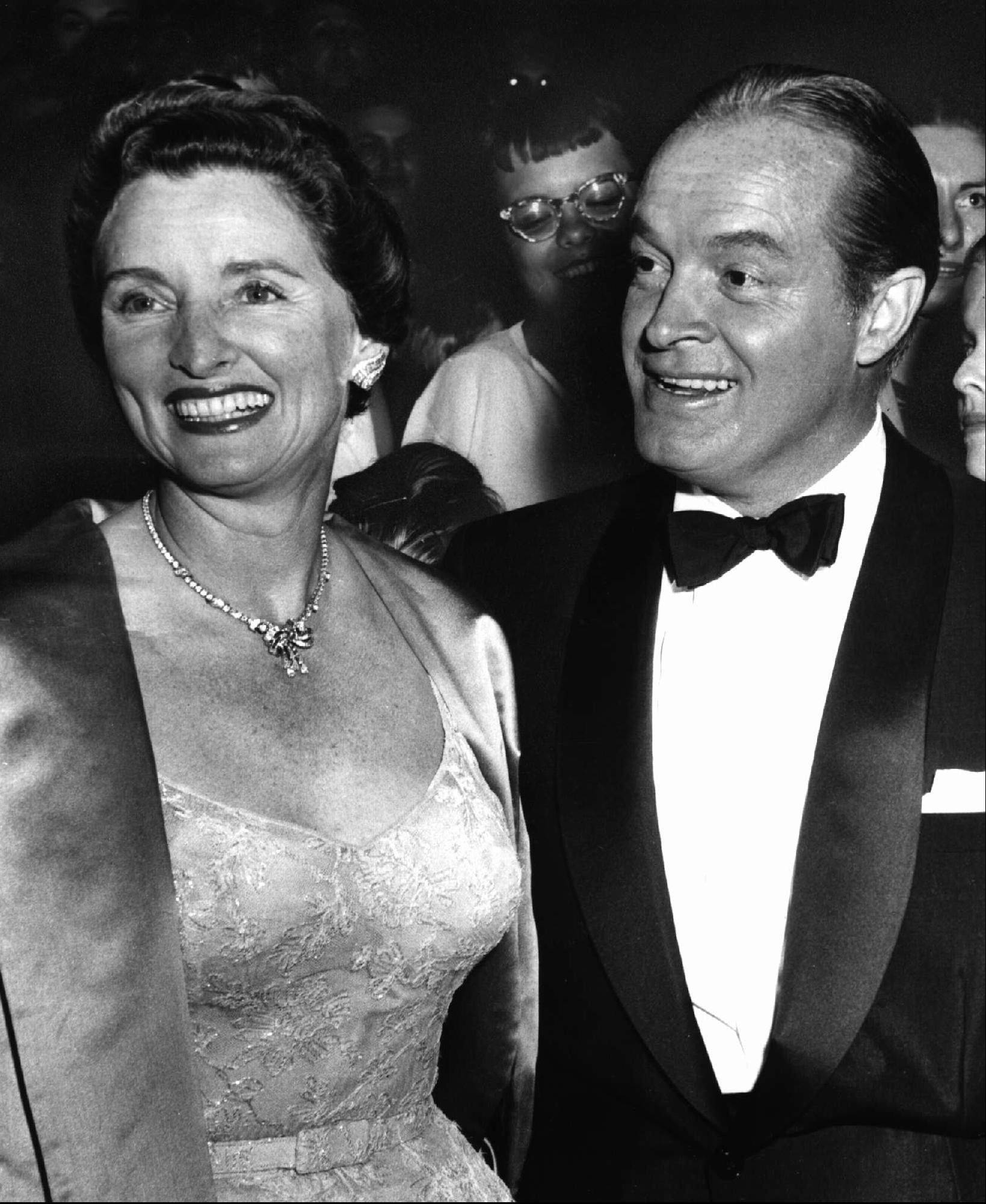 "In this 1955 file photo, entertainer Bob Hope, right, and his wife Dolores attend the premiere of Hope's movie ""The Seven Little Foys"" at a Paramount Theater in Los Angeles."