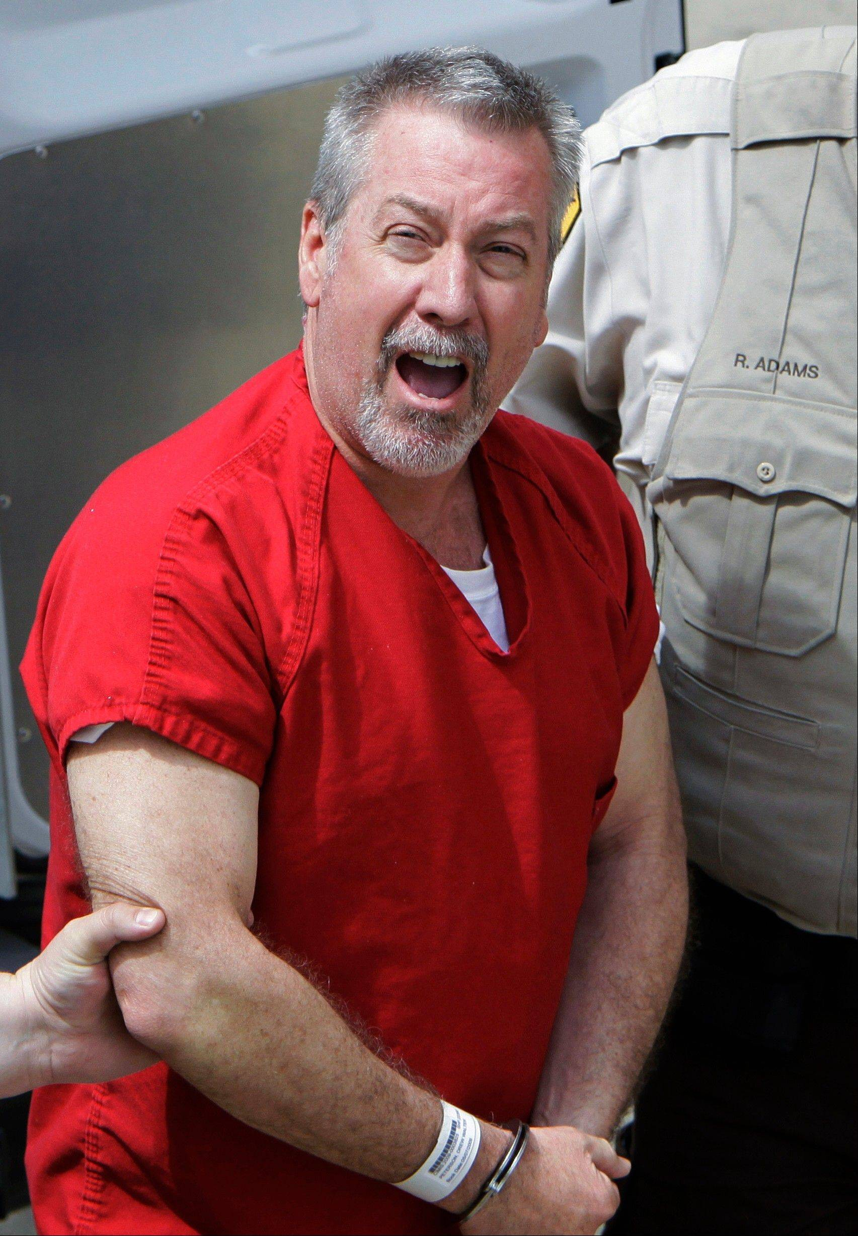FILE - In this May 8, 2009 file photo, former Bolingbrook, Ill., police sergeant Drew Peterson yells to reporters as he arrives at the Will County Courthouse in Joliet, Ill. A state appellate court on Tuesday, July 26, 2011 refused to overturn a Will County judge's decision barring prosecutors from using some hearsay, or second hand, evidence against former Bolingbrook police Sgt. Drew Peterson. Peterson is charged with first-degree murder in the 2004 slaying of third wife Kathleen Savio. He also is a suspect in the 2007 disappearance of his fourth wife, Stacy Peterson. (AP Photo/M. Spencer Green, File)