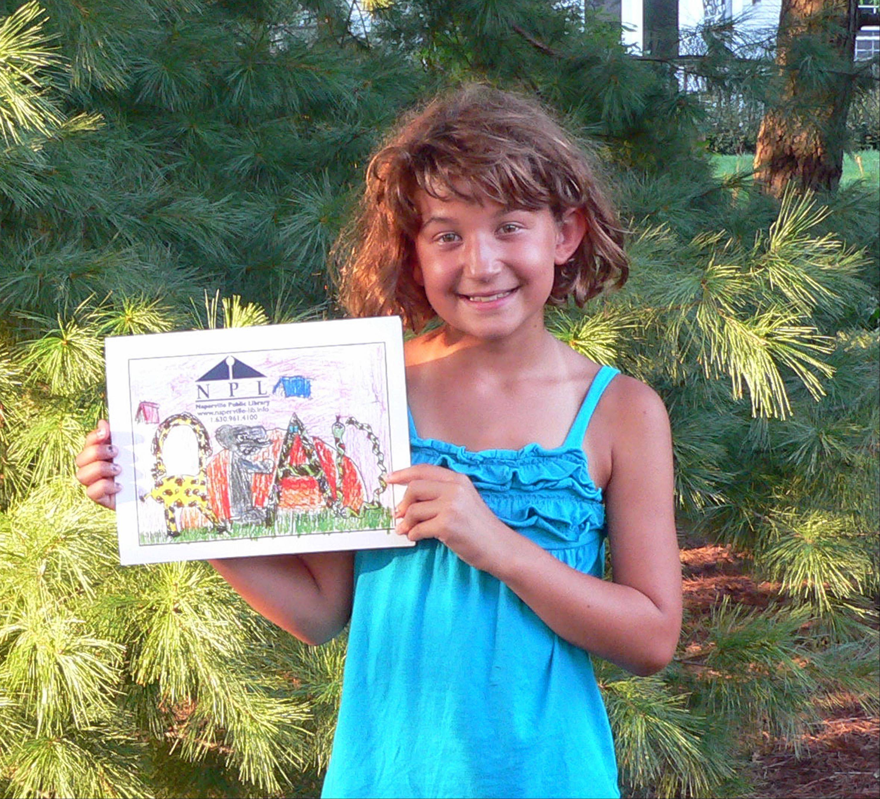 Olivia Carlson shows the winning design she entered in the Naperville Public Library Children�s Card Contest.