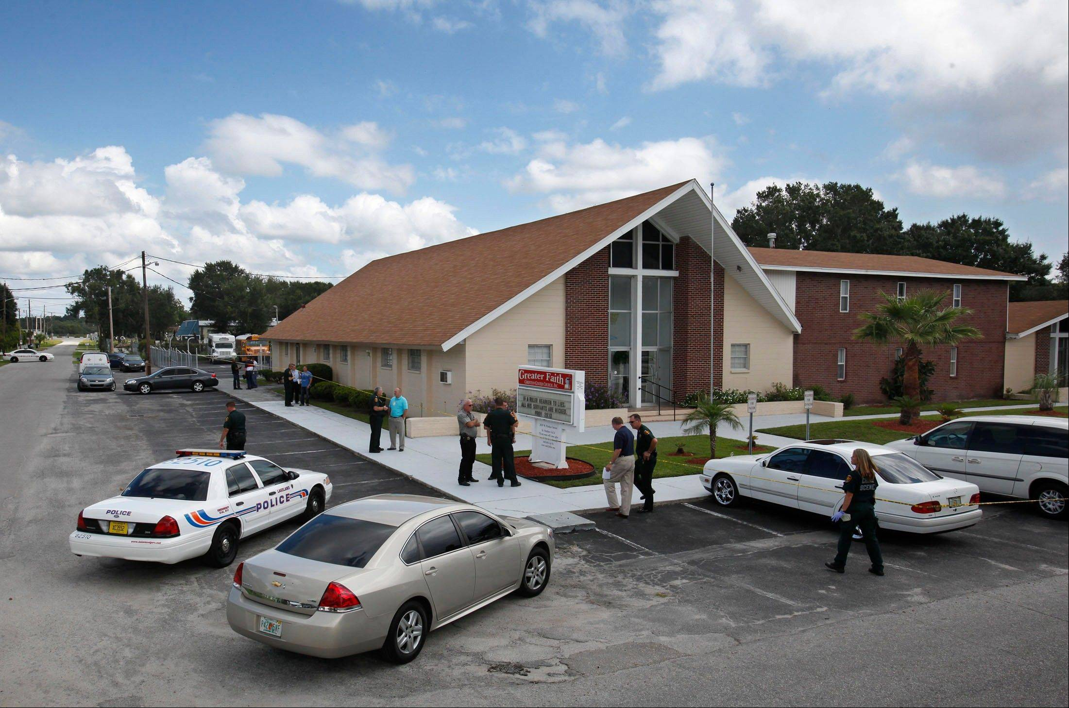 A gunman killed his wife at their Lakeland, Fla., home and then burst through the front door of a nearby church on Sunday, wounding a pastor and associate pastor before parishioners tackled him, authorities and relatives said.