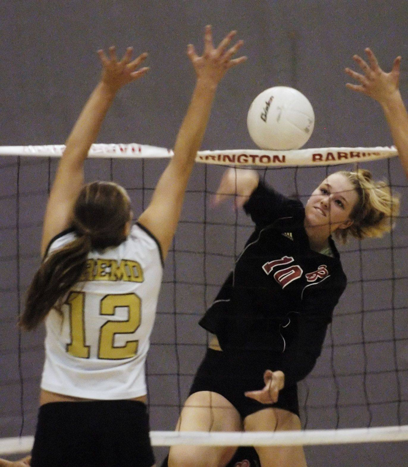 Barrington�s Lauren Shectman, right, attempts a kill as Fremd�s Nicole Obos defends at the net during Tuesday�s game.