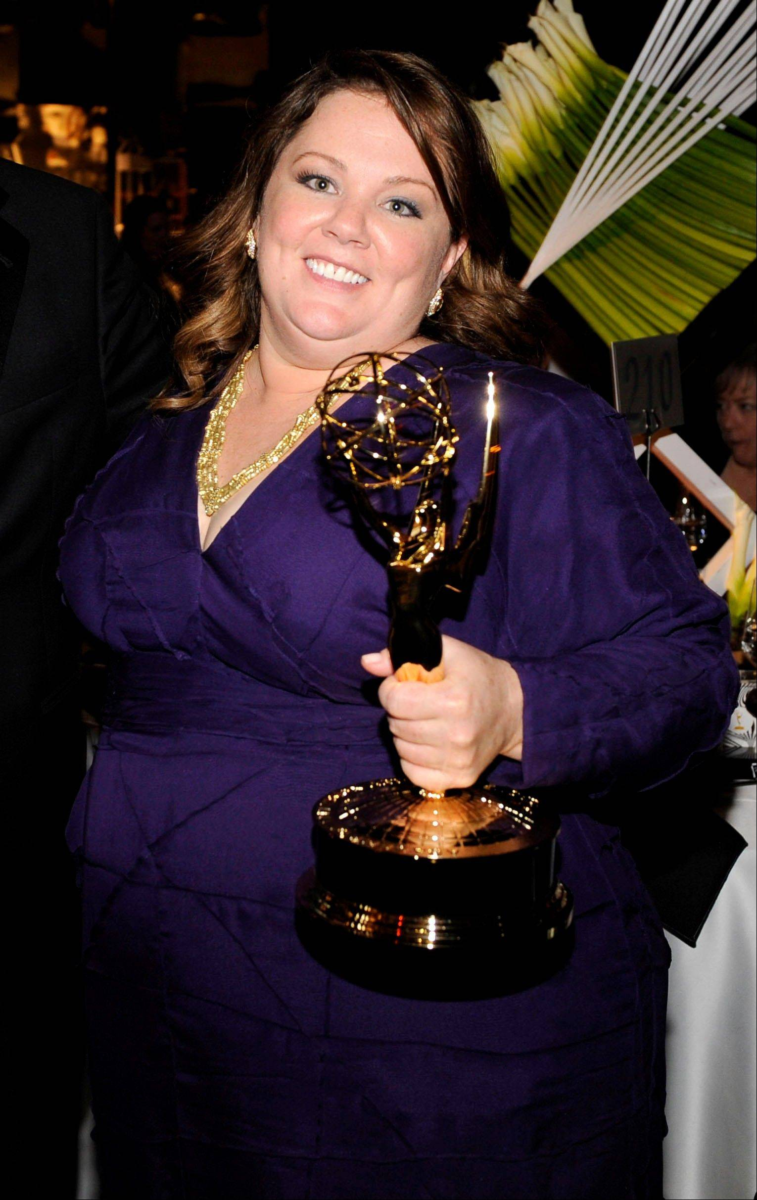 "Melissa McCarthy, who won for outstanding lead actress in a comedy series for ""Mike & Molly,"" takes in the 63rd Primetime Emmy Awards Governors Ball on Sunday."