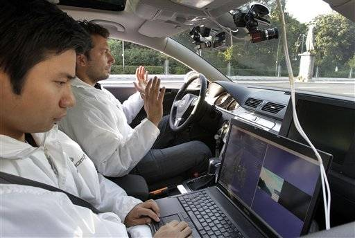 Research assistant Miao Wang, left, and project manager Tinosh Ganjineh, of the Autonomos Labs inside a car in Berlin, Germany.