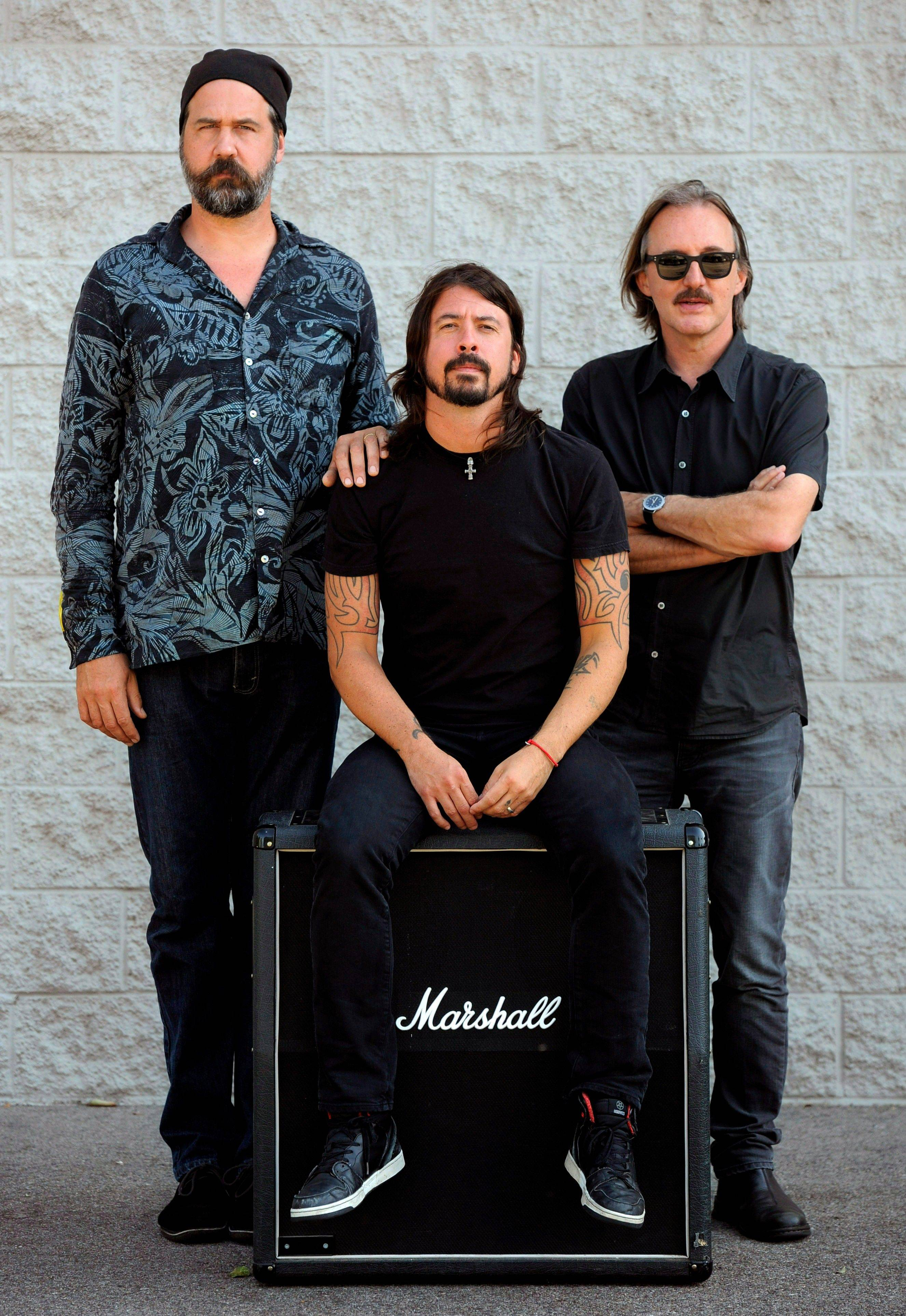 "Krist Novoselic, left, and Dave Grohl, center, former members of the band Nirvana, and Butch Vig, producer of the band's landmark 1991 album ""Nevermind,"" remember Nirvana from back in the day."