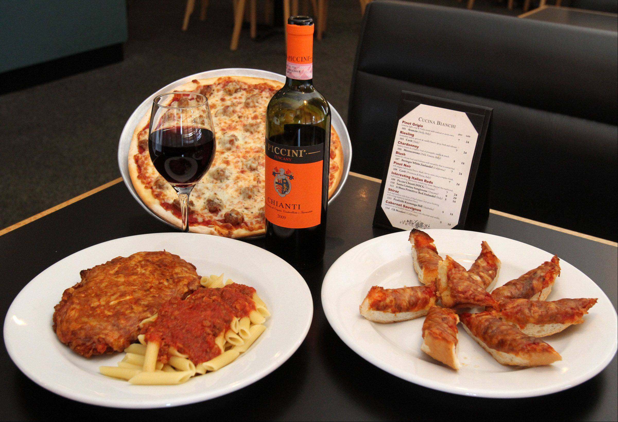 Generous portions of Italian family favorite like pizza bread, chicken parmesan, and sausage pizza are served at Cucina Bianchi Ristorante and Pizzeria in Elk Grove Village.